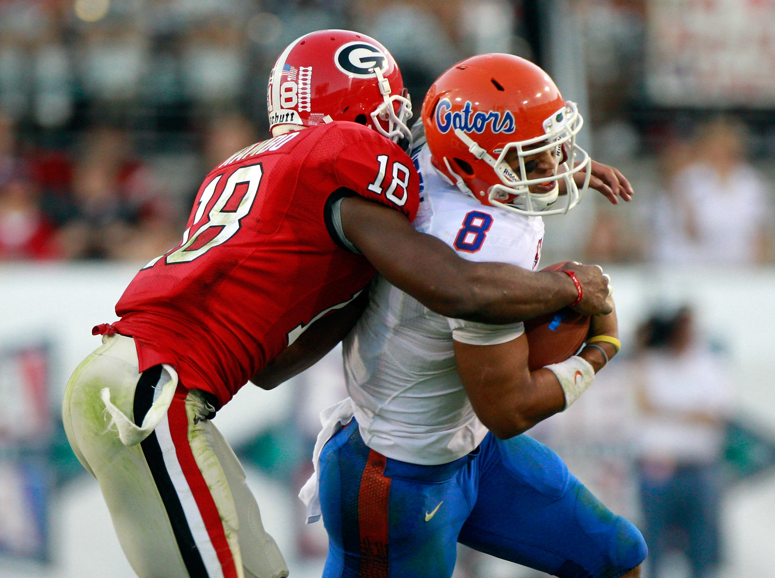 JACKSONVILLE, FL - OCTOBER 30:  Trey Burton #8 of the Florida Gators is tackled by Bacarri Rambo#18 of the Georgia Bulldogs during the game at EverBank Field on October 30, 2010 in Jacksonville, Florida.  (Photo by Sam Greenwood/Getty Images)