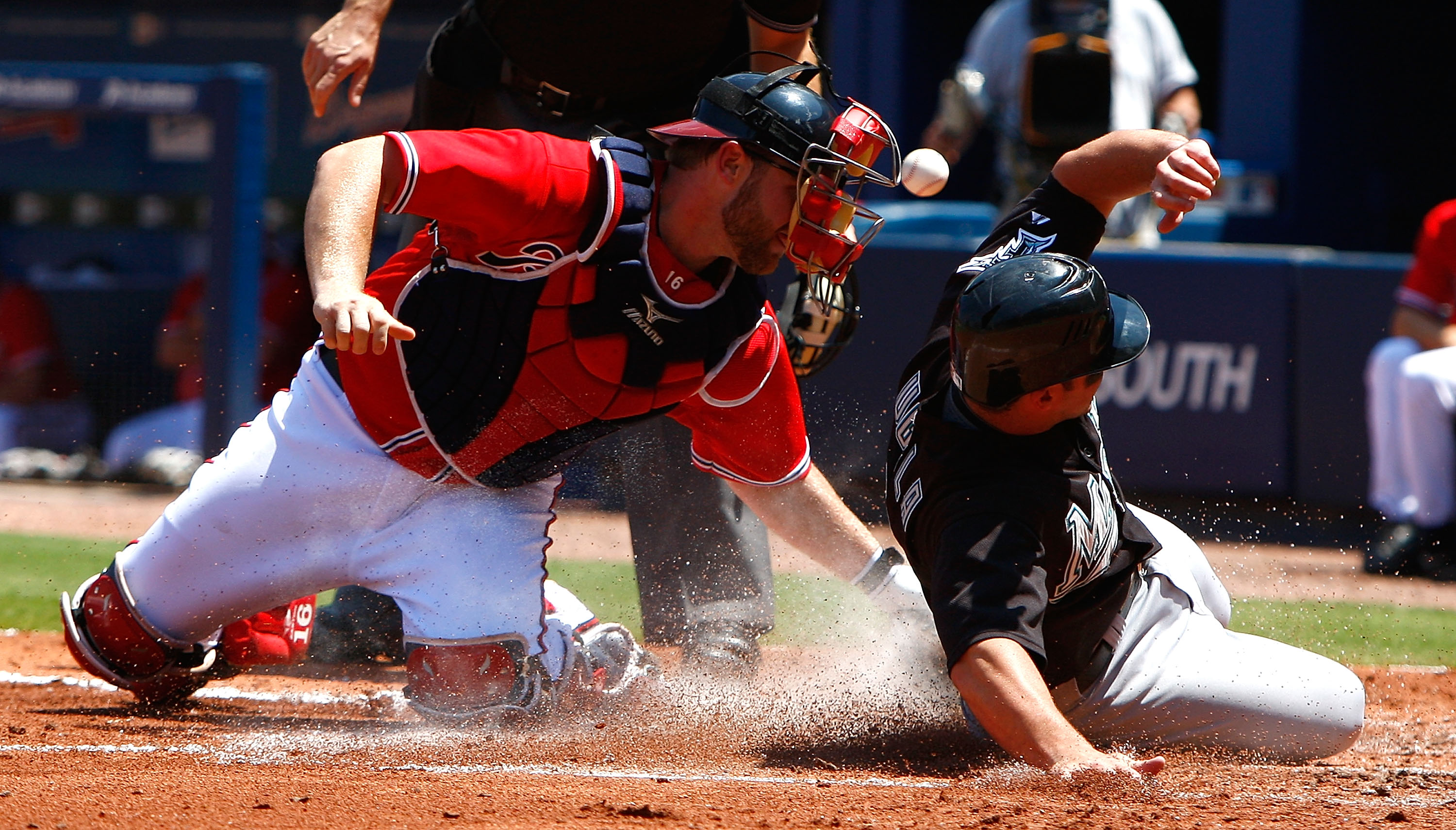 ATLANTA - AUGUST 23:  Catcher Brian McCann #16 of the Atlanta Braves loses the ball as Dan Uggla #6 of the Florida Marlins slides safely across homeplate on August 23, 2009 at Turner Field in Atlanta, Georgia.  (Photo by Kevin C. Cox/Getty Images)