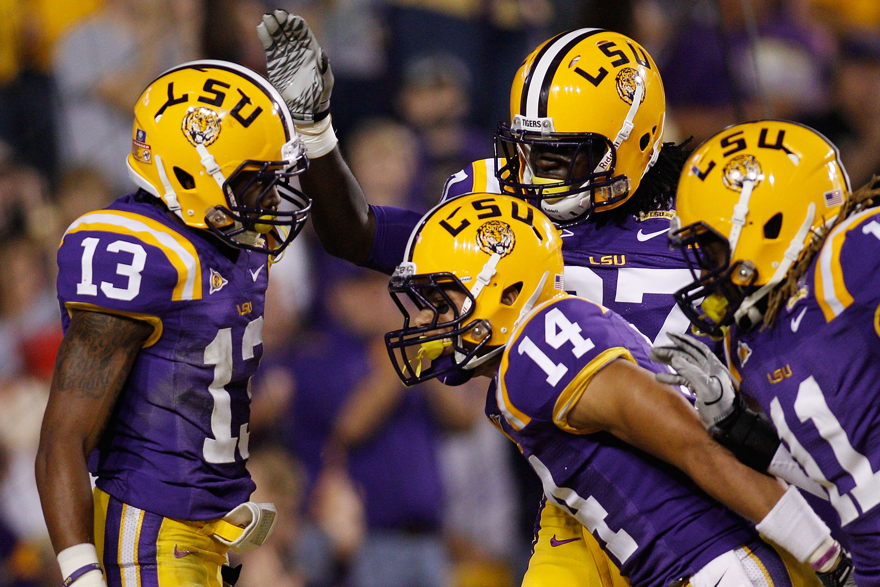 BATON ROUGE, LA - NOVEMBER 13:  Ron Brooks #13 of the Louisiana State University Tigers celebrates after scoring a touchdown on an interception during the game against the University of Louisiana-Monroe Warhawks at Tiger Stadium on November 13, 2010 in Ba
