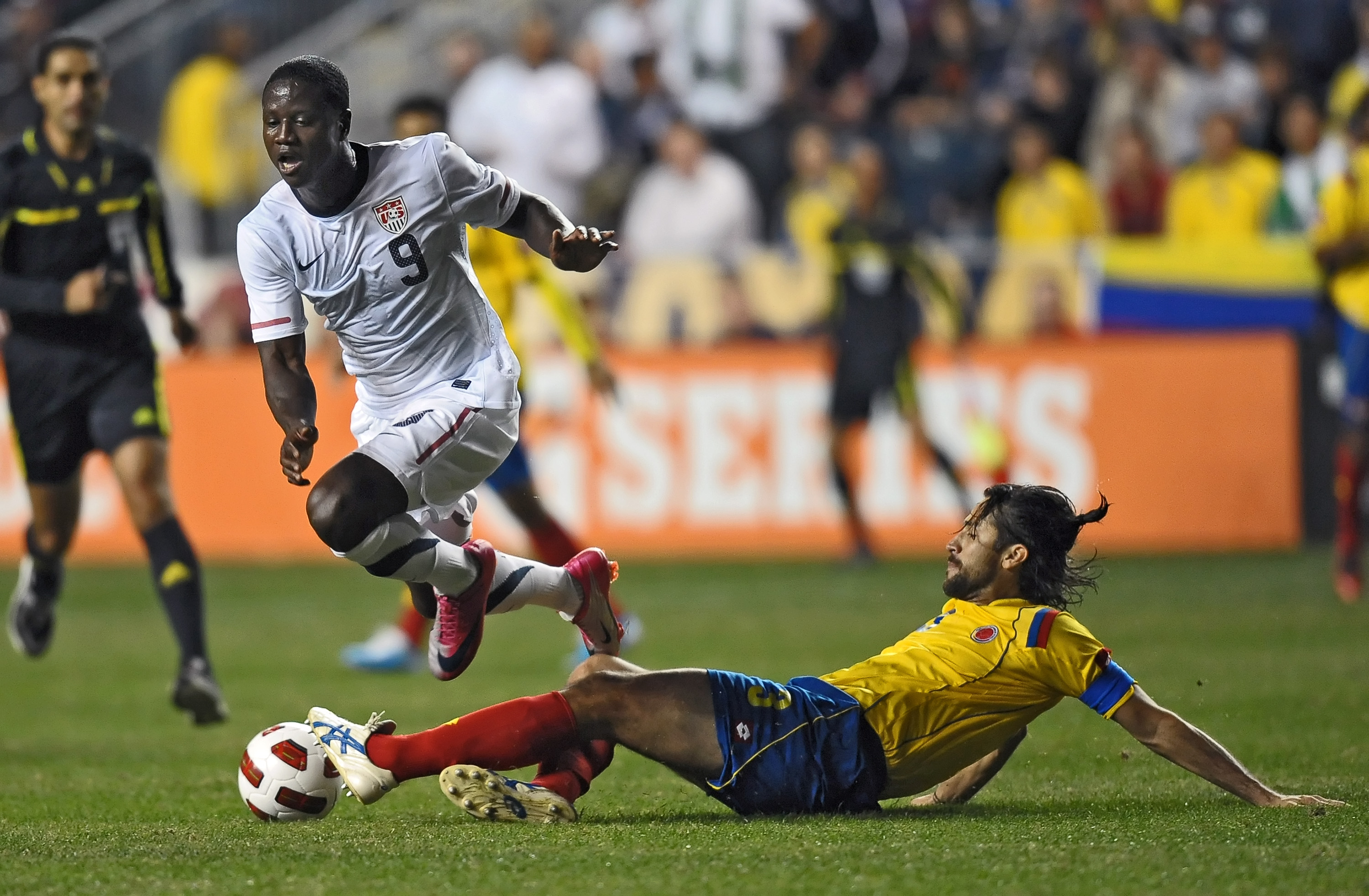 CHESTER, PA - OCTOBER 12: Eddie Johnson #9 of the United States gets tripped up by a sliding Mario Yepes #3 of Colombia at PPL Park on October 12, 2010 in Chester, Pennsylvania. The game ended in a 0-0 tie. (Photo by Drew Hallowell/Getty Images)