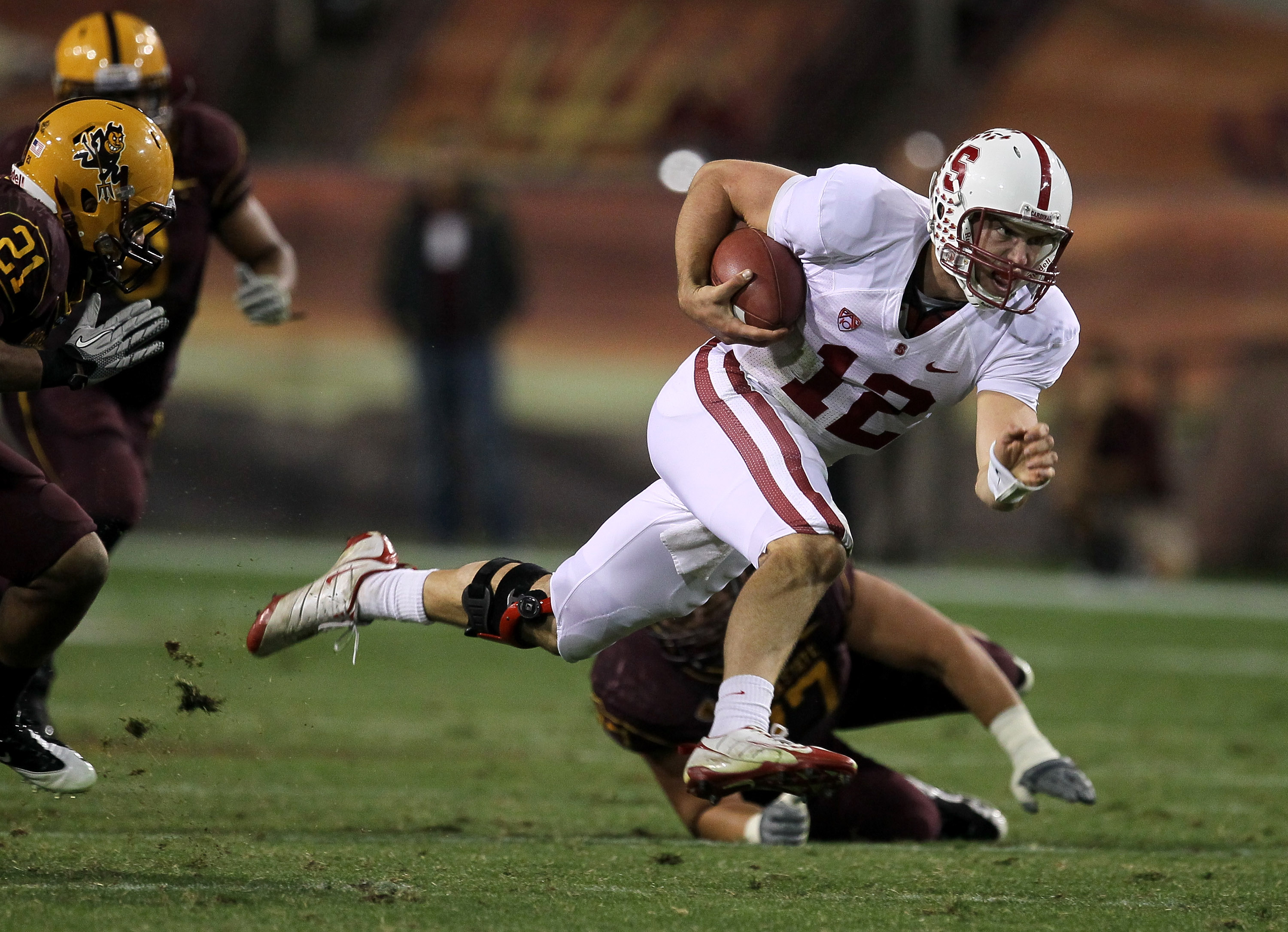 TEMPE, AZ - NOVEMBER 13:  Quarterback Andrew Luck #12 of the Stanford Cardinal scrambles for a first down against the Arizona State Sun Devils at Sun Devil Stadium on November 13, 2010 in Tempe, Arizona.The Cardinal won 17-13.  (Photo by Stephen Dunn/Gett