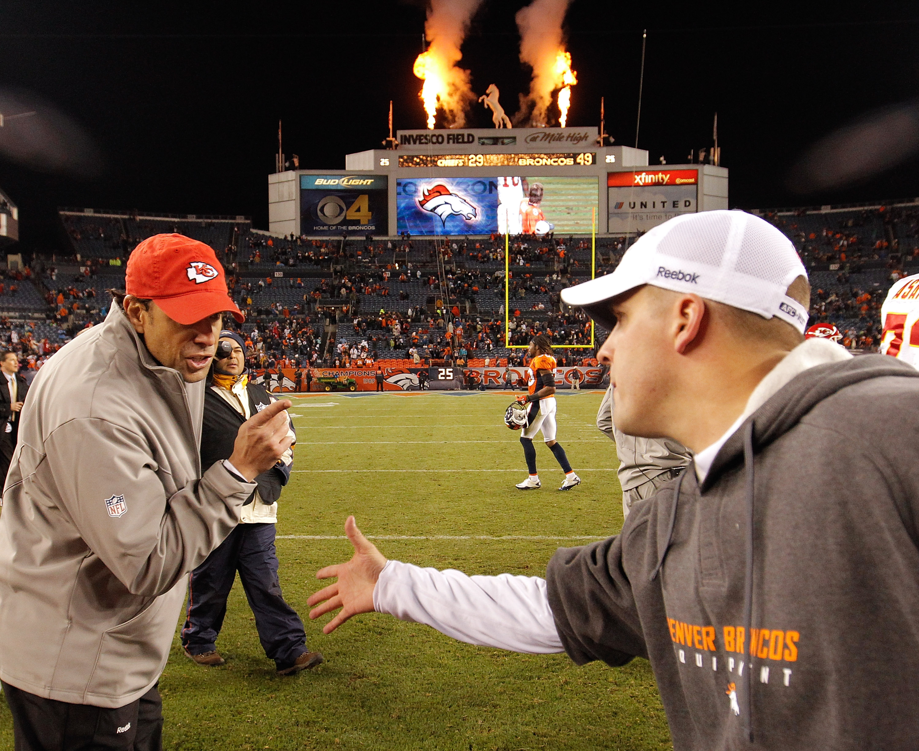 DENVER - NOVEMBER 14:  Head coach Todd Haley of the Kansas City Chiefs has some unwelcome words with head coach Josh McDaniels of the Denver Broncos as he refuses to shake his hand after the Broncos 49-29 win at INVESCO Field at Mile High on November 14,
