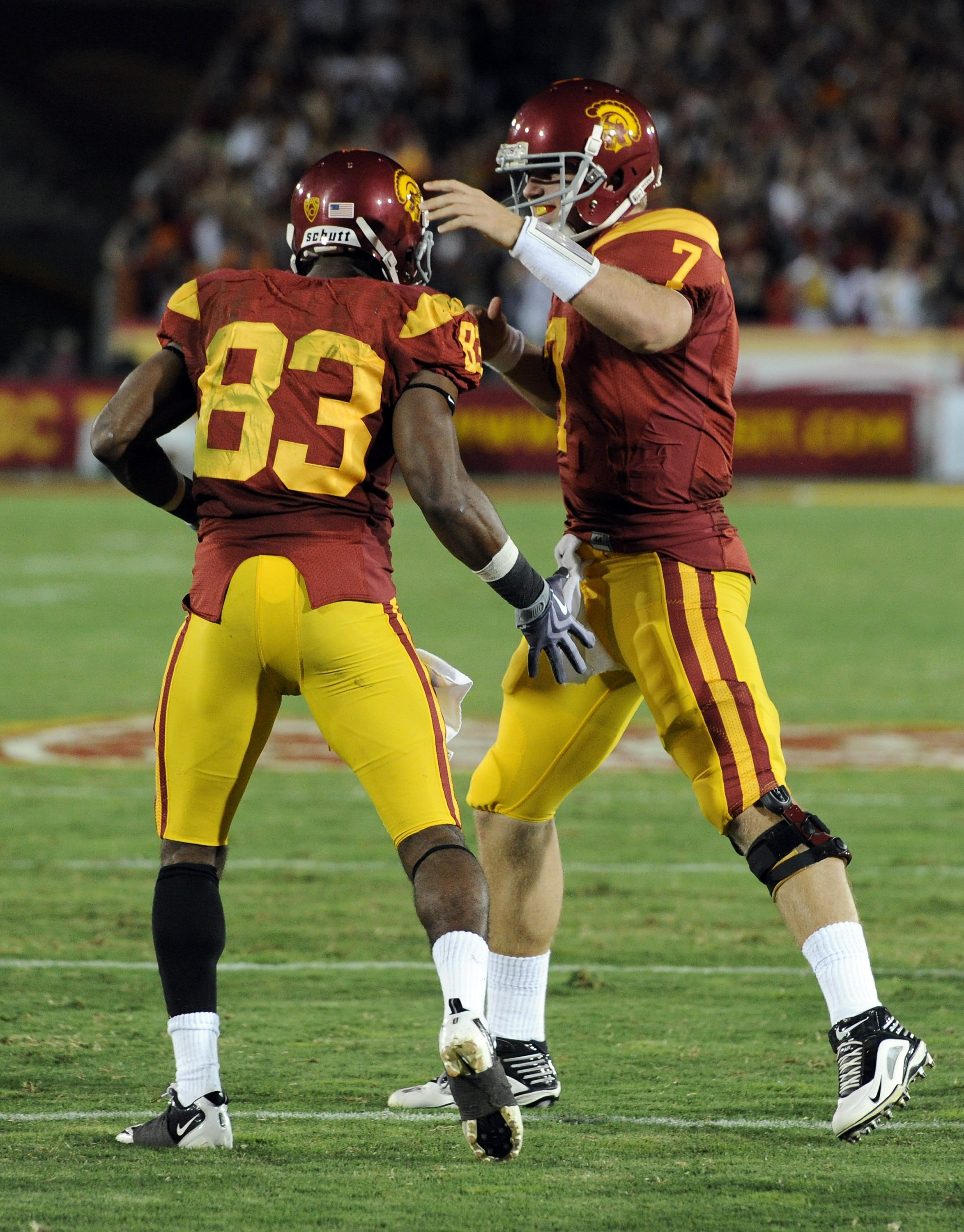 LOS ANGELES, CA - OCTOBER 30:  Matt Barkley #7 and Ronald Johnson #83 of USC Trojans celebrate a touchdown to trail 24-29 against the Oregon Ducks during the third quarter at Los Angeles Memorial Coliseum on October 30, 2010 in Los Angeles, California.  (