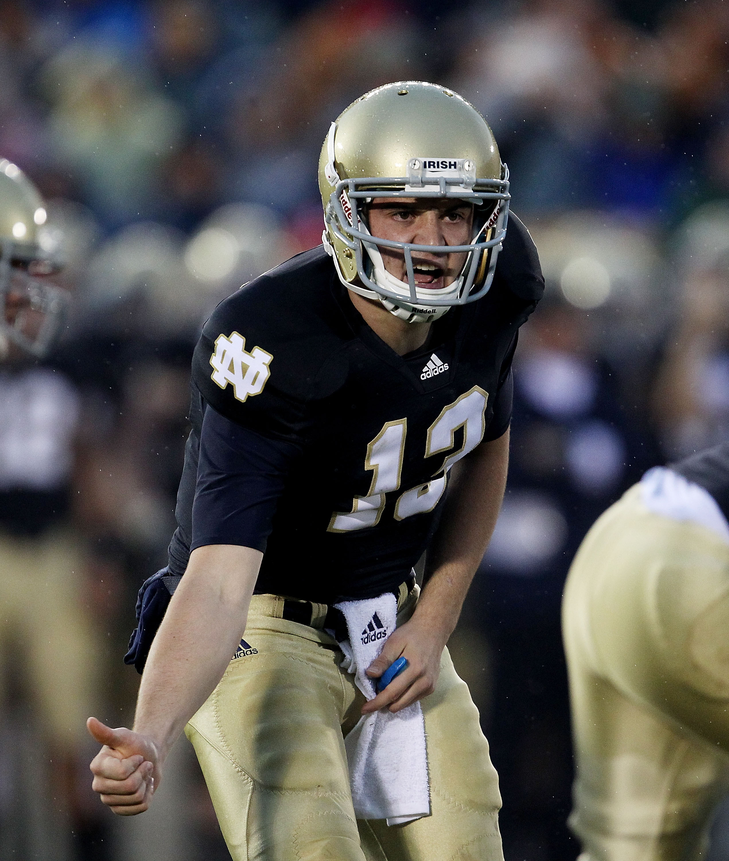 SOUTH BEND, IN - NOVEMBER 13: Tommy Rees #13 of the Notre Dame Fighting Irish calls a play at the line of scrimmage against the Utah Utes at Notre Dame Stadium on November 13, 2010 in South Bend, Indiana. (Photo by Jonathan Daniel/Getty Images)