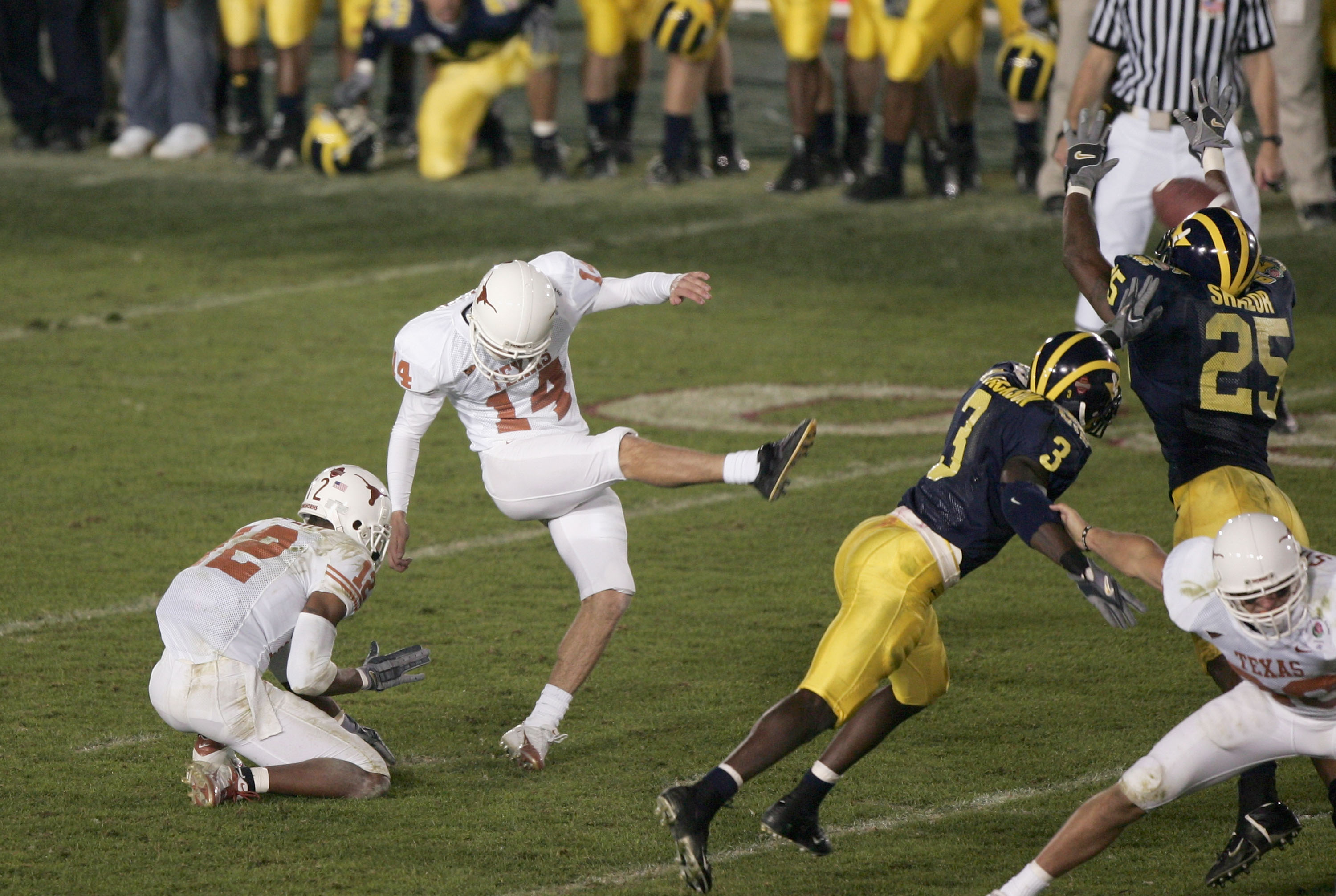 PASADENA, CA - JANUARY 01:  Kicker Dusty Mangum #14 of the Texas Longhorns kicks the game winning field goal against the Michigan Wolverines in the 91st Rose Bowl Game at the Rose Bowl on January 1, 2005 in Pasadena, California.   Texas defeated Michigan