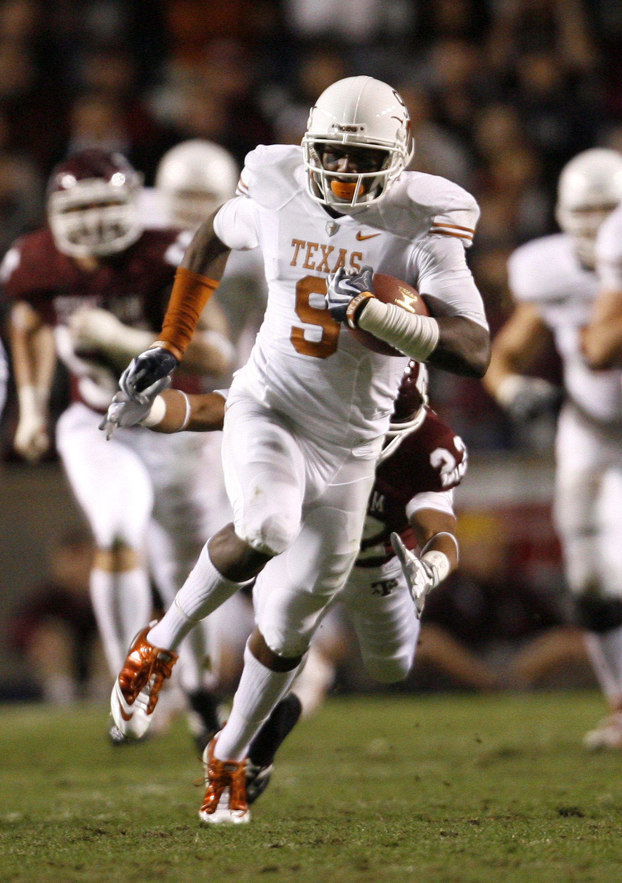COLLEGE STATION, TX - NOVEMBER 26:  Wide receiver Malcolm Williams #9 of the Texas Longhorns runs for a gain after making a reception against the Texas A&M Aggies in the first half at Kyle Field on November 26, 2009 in College Station, Texas. The Longhorn