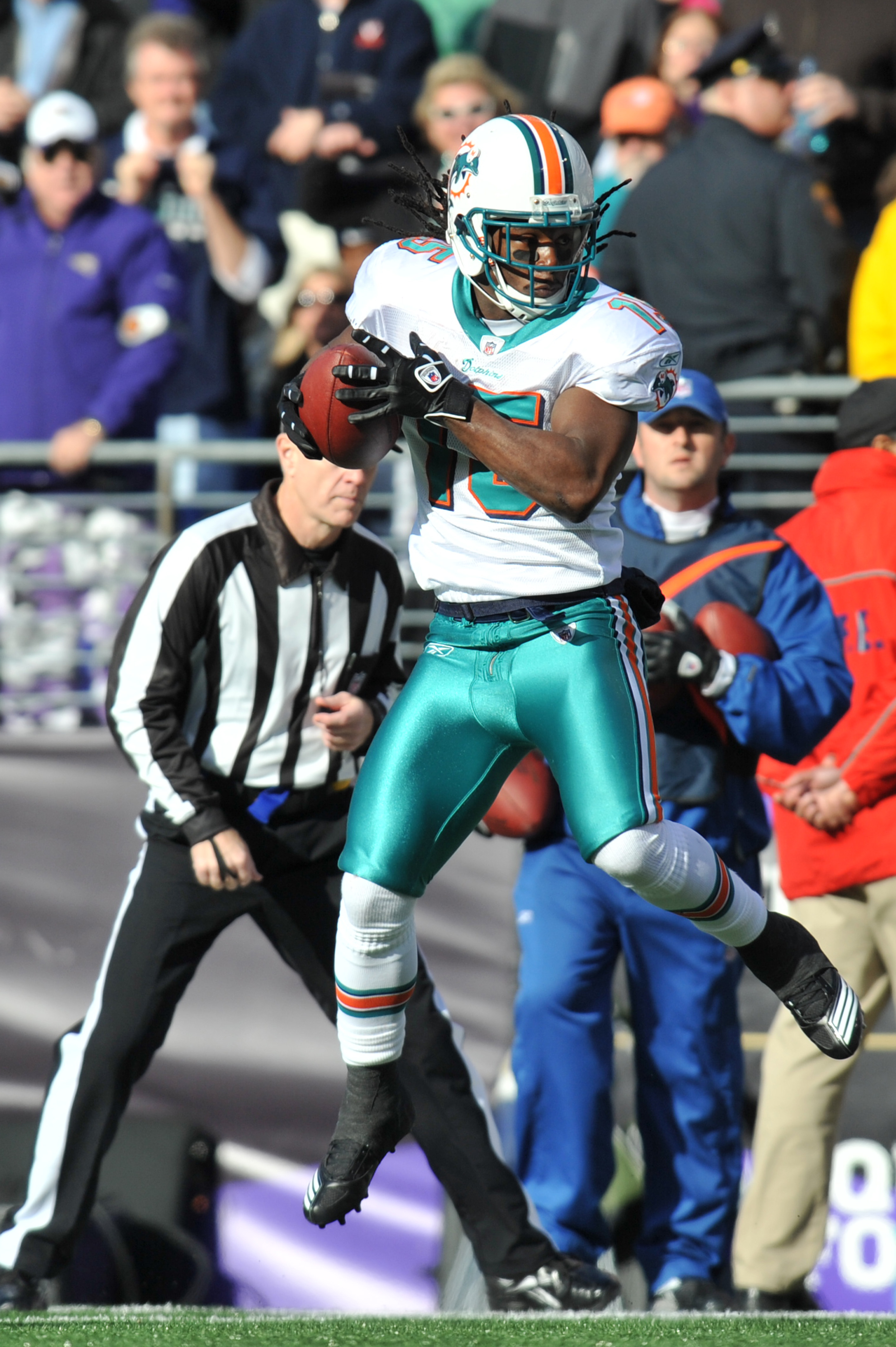 BALTIMORE, MD - NOVEMBER 7:  Davone Bess #15 of the Miami Dolphins makes a catch against the Baltimore Ravens at M&T Bank Stadium on November 7, 2010 in Baltimore, Maryland. The Ravens defeated the Dolphins 26-10. (Photo by Larry French/Getty Images)
