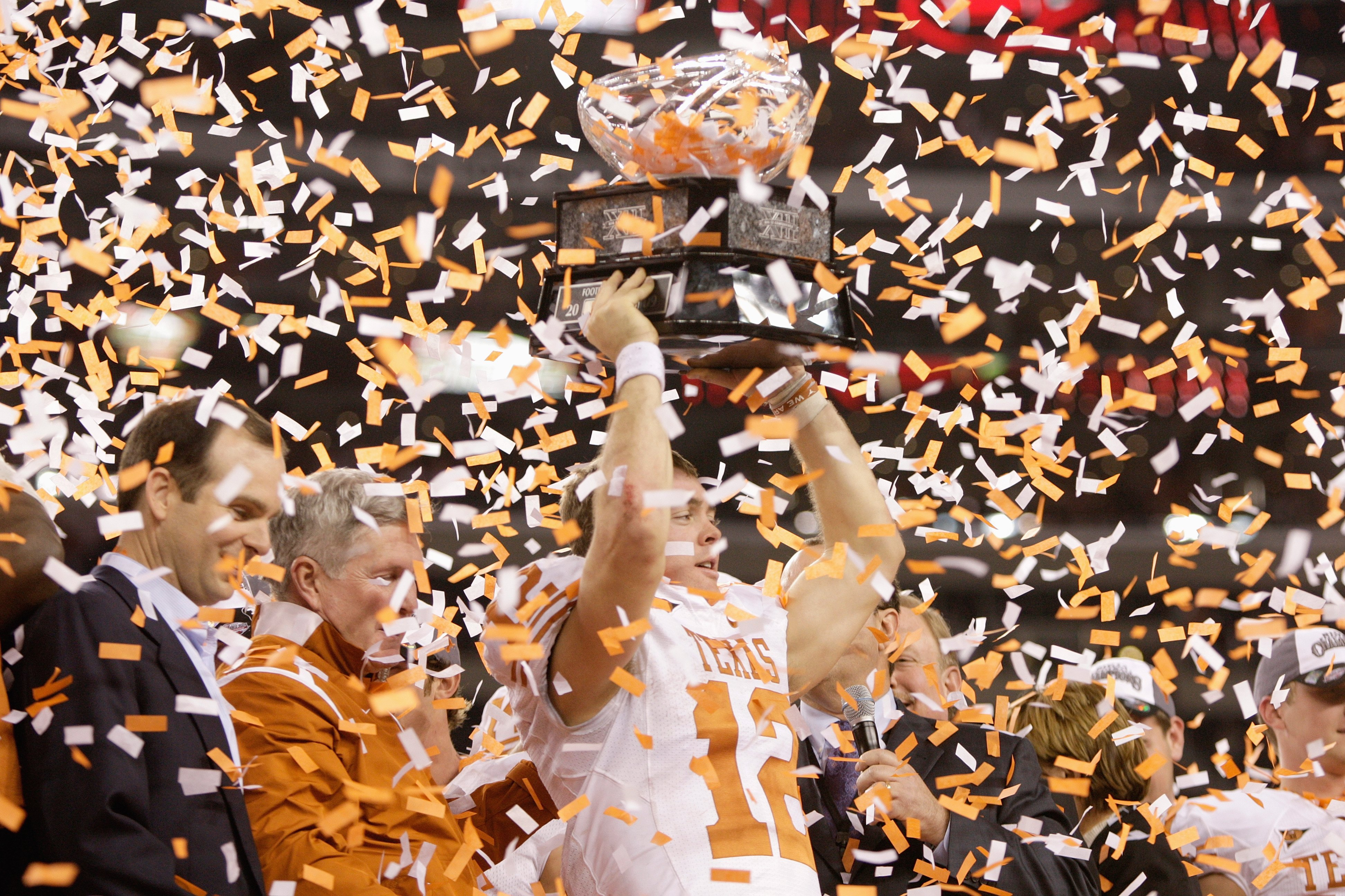 ARLINGTON, TX - DECEMBER 5: Colt McCoy #12 of the Texas Longhorns lifts the trophy after winning the Big 12 Football Championship game against the Nebraska Cornhuskers at Cowboys Stadium on December 5, 2009 in Arlington, Texas. (Photo by Jamie Squire/Gett