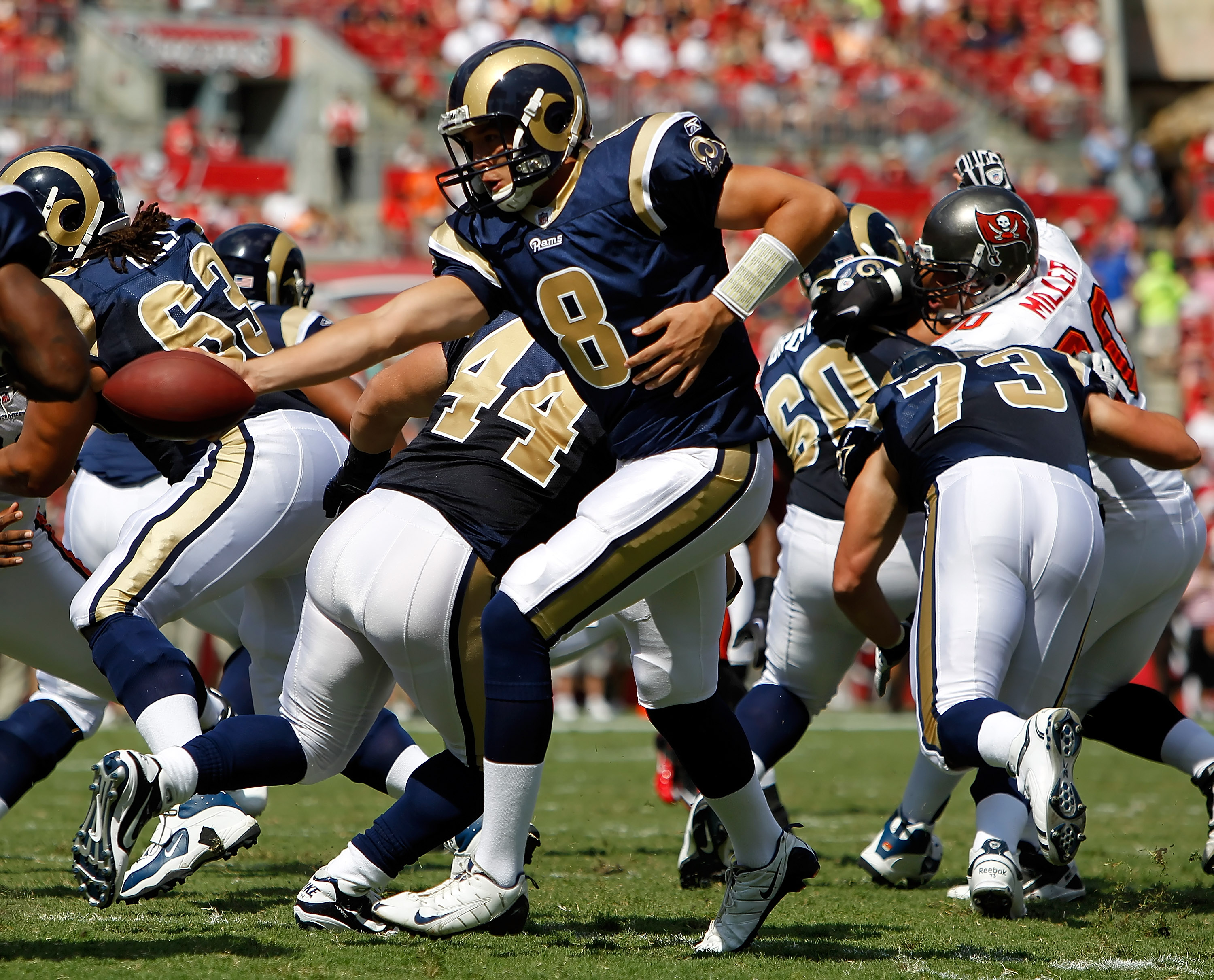 TAMPA, FL - OCTOBER 24:  Quarterback Sam Bradford #8 of the St. Louis Rams hands the ball off against the Tampa Bay Buccaneers during the game at Raymond James Stadium on October 24, 2010 in Tampa, Florida.  (Photo by J. Meric/Getty Images)