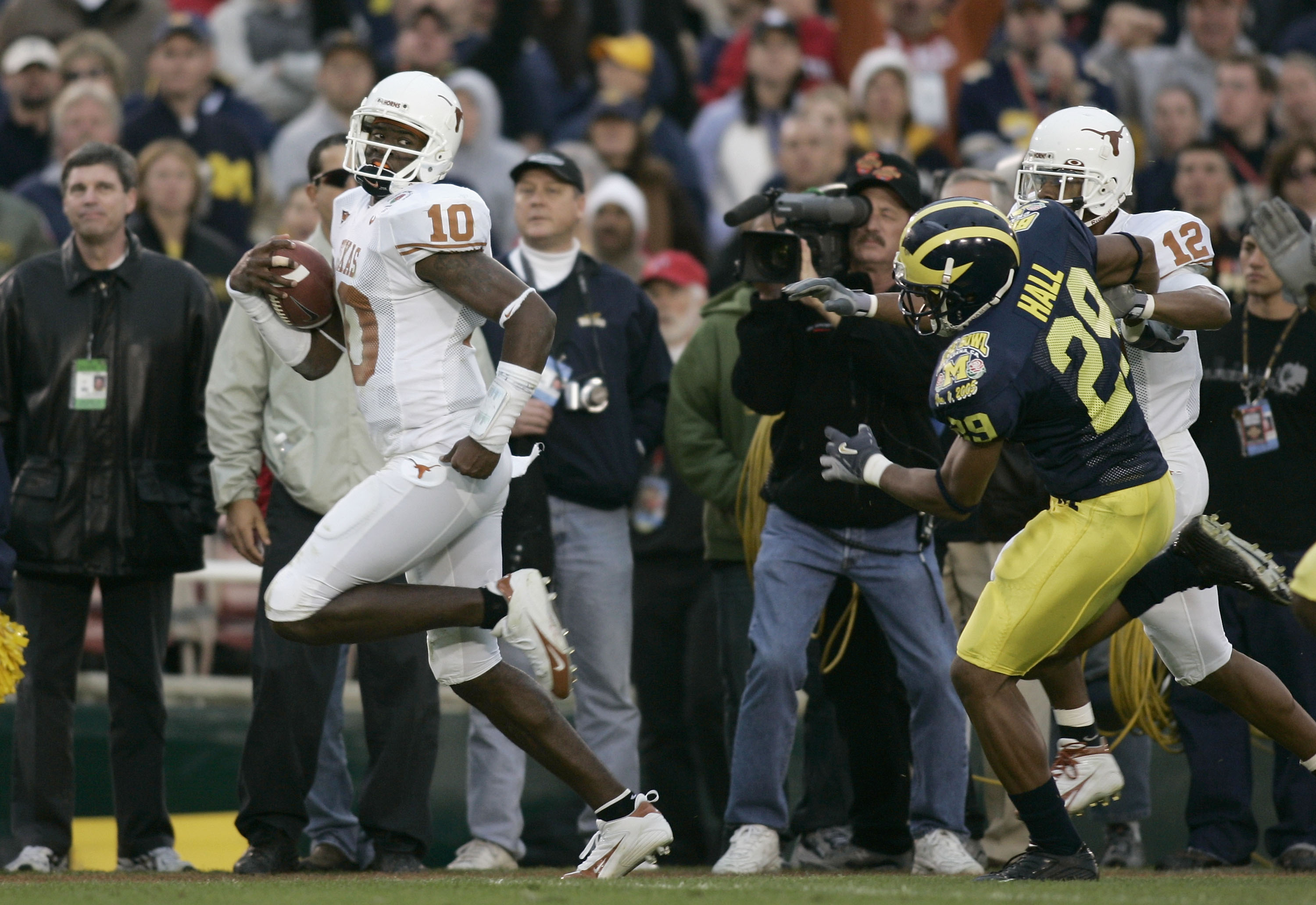 PASADENA, CA - JANUARY 01:  Quarterback Vince Young #10 of the Texas Longhorns scores his second rushing touchdown past Leon Hall #29 of the Michigan Wolverines in the 91st Rose Bowl Game at the Rose Bowl on January 1, 2005 in Pasadena, California.    (Ph