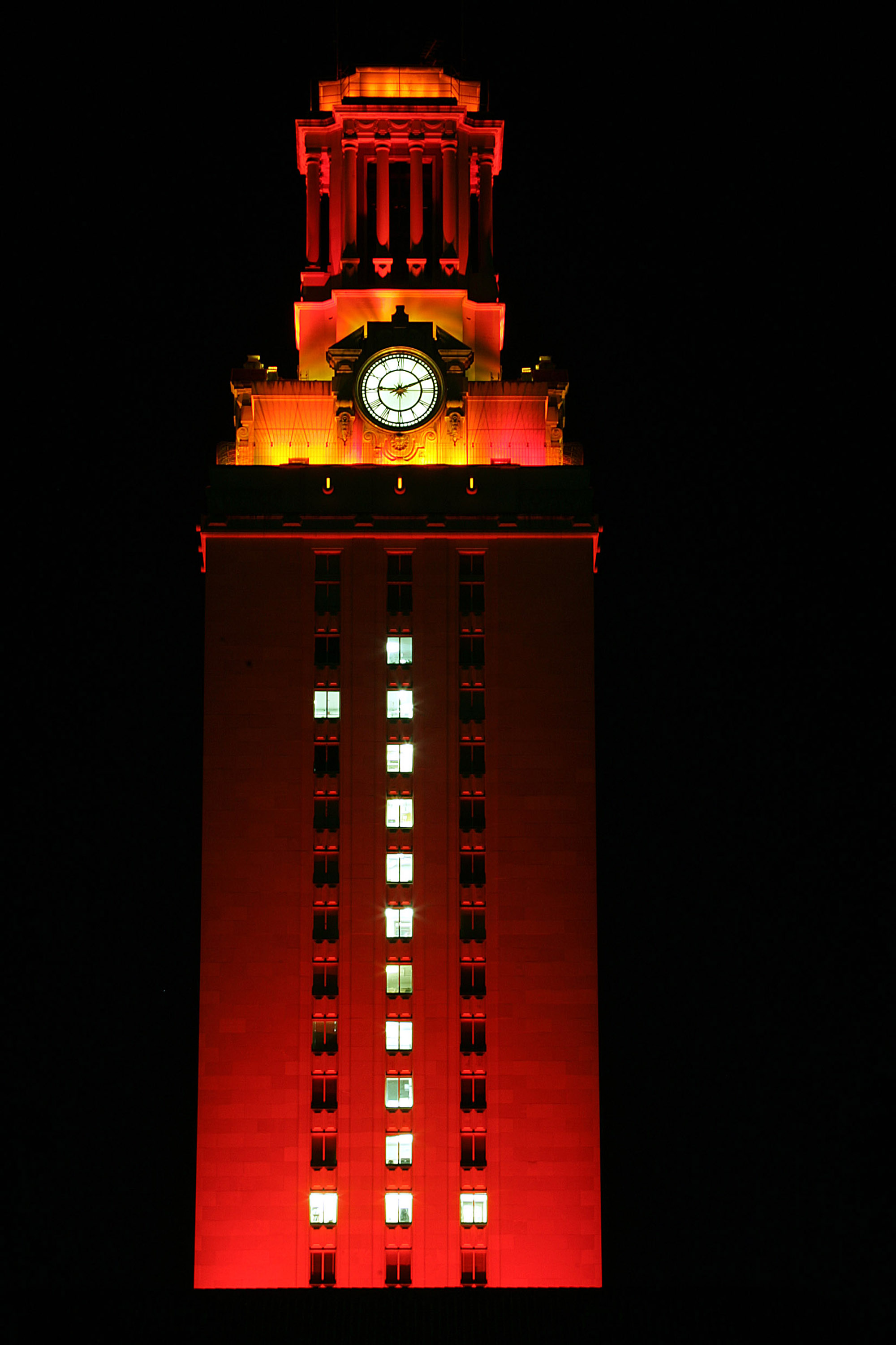 AUSTIN, TX - JANUARY 7:  The University of Texas Tower is lit burnt orange with a number 1 in recognition of the Texas Longhorns national college football championship on January 7, 2006 in Austin, Texas.  (Photo by Ronald Martinez/Getty Images)