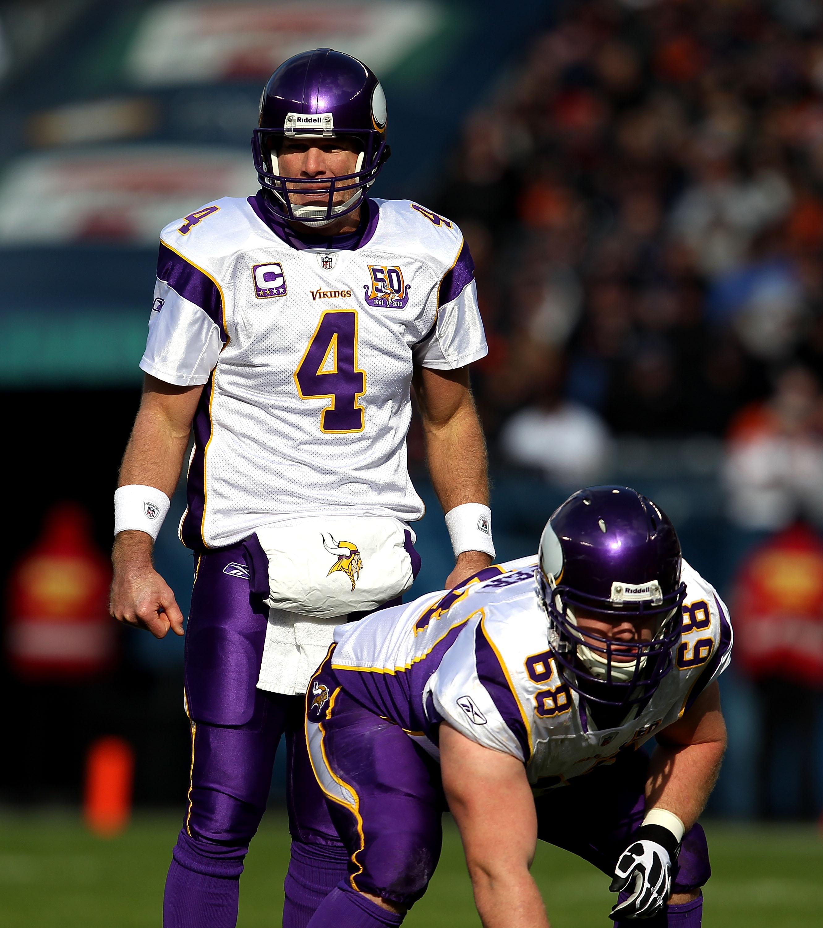 CHICAGO - NOVEMBER 14: Brett Favre #4 of the Minnesota Vikings looks over the Chicago Bear defense before taking the snap from Jon Cooper #68 at Soldier Field on November 14, 2010 in Chicago, Illinois. The Bears defeated the Vikings 27-13.  (Photo by Jona