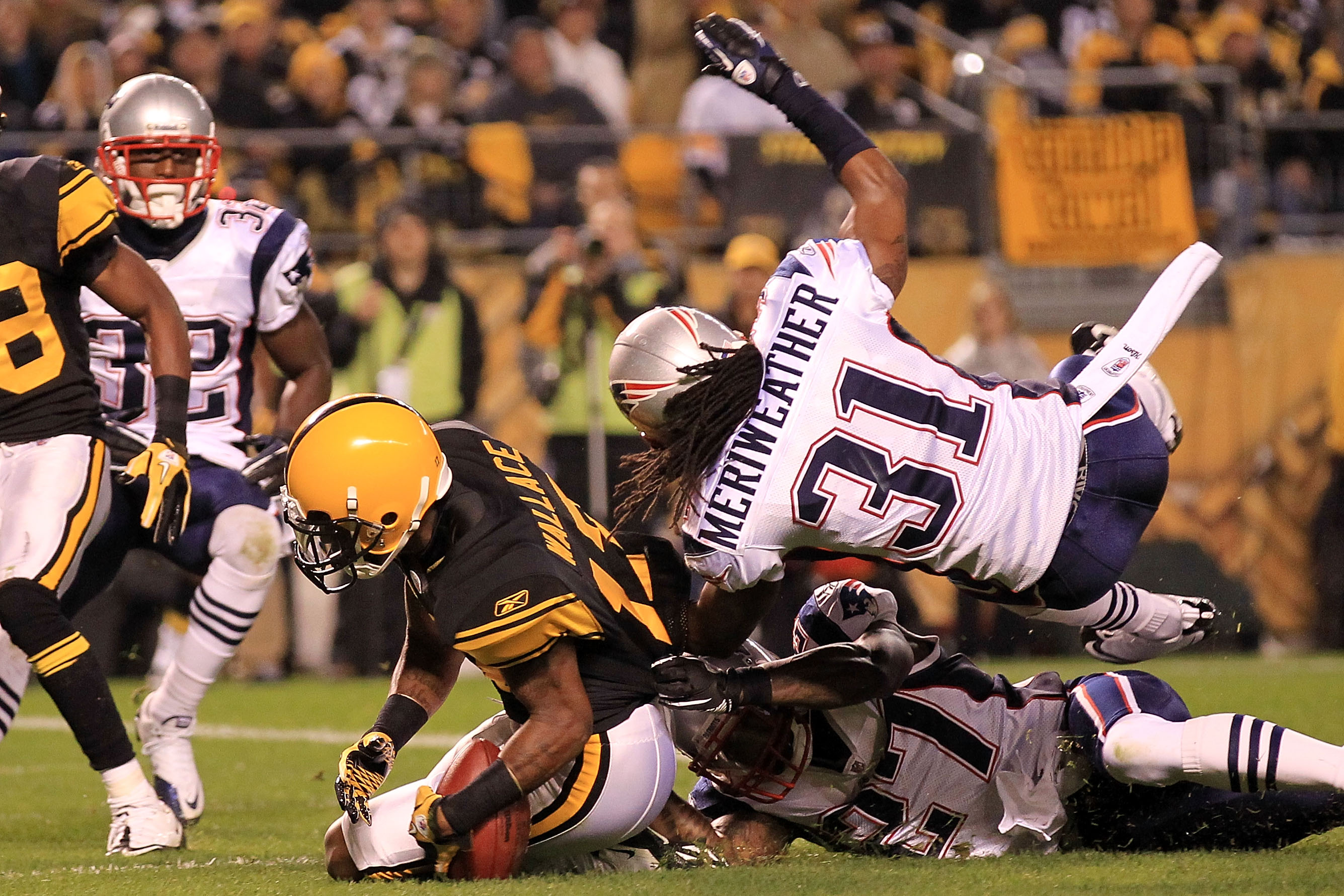 PITTSBURGH - NOVEMBER 14:  Mike Wallace #17 of the Pittsburgh Steelers drops the ball in the endzone under pressure from Brandon Meriweather #31 and Kyle Arrington #27 of the New England Patriots on November 14, 2010 at Heinz Field in Pittsburgh, Pennsylv