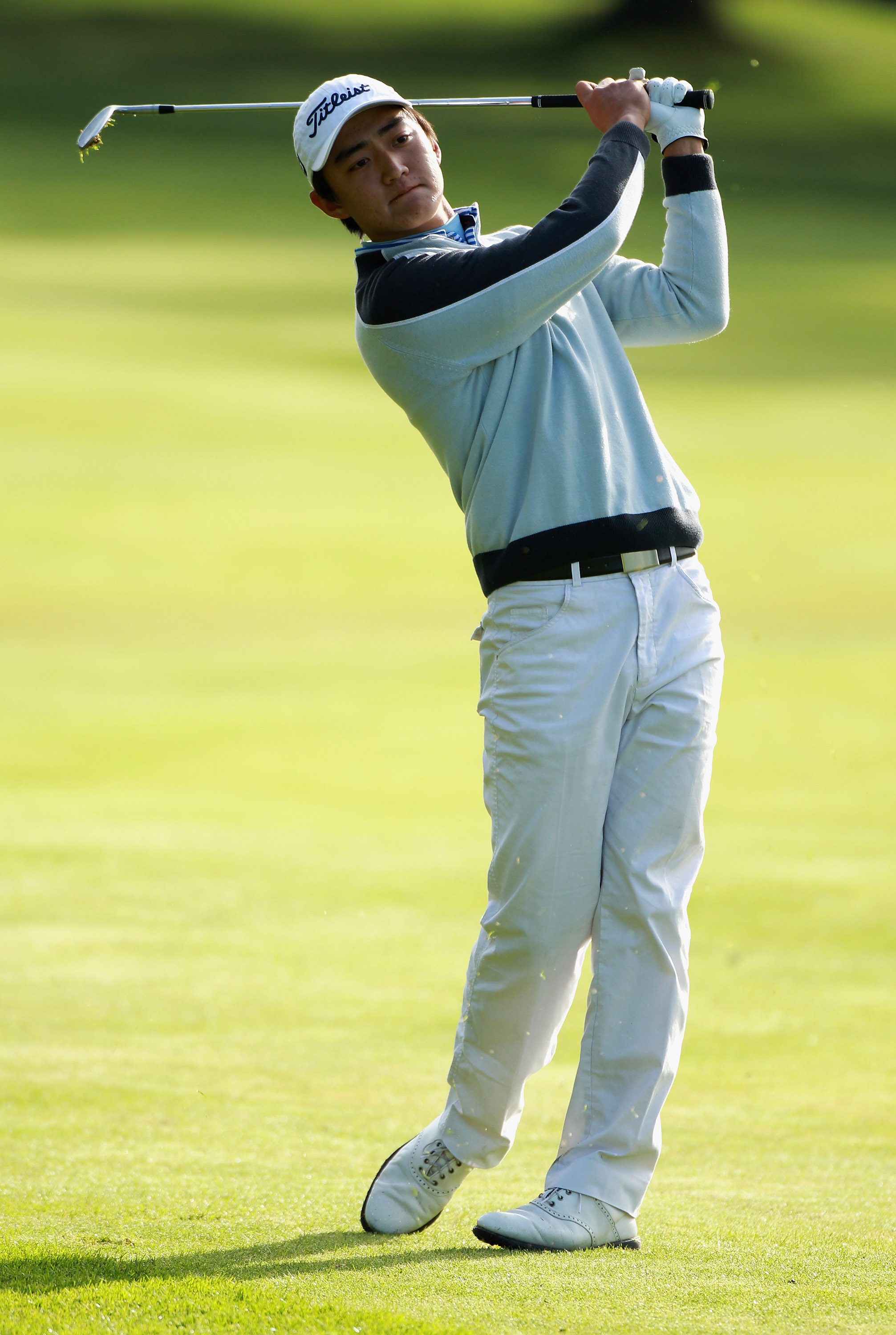 CRANS, SWITZERLAND - SEPTEMBER 02:  Amateur,  Jin Jeong of Australia plays his second shot into the 10th green during the first round of The Omega European Masters at Crans-Sur-Sierre Golf Club on September 2, 2010 in Crans Montana, Switzerland.  (Photo b
