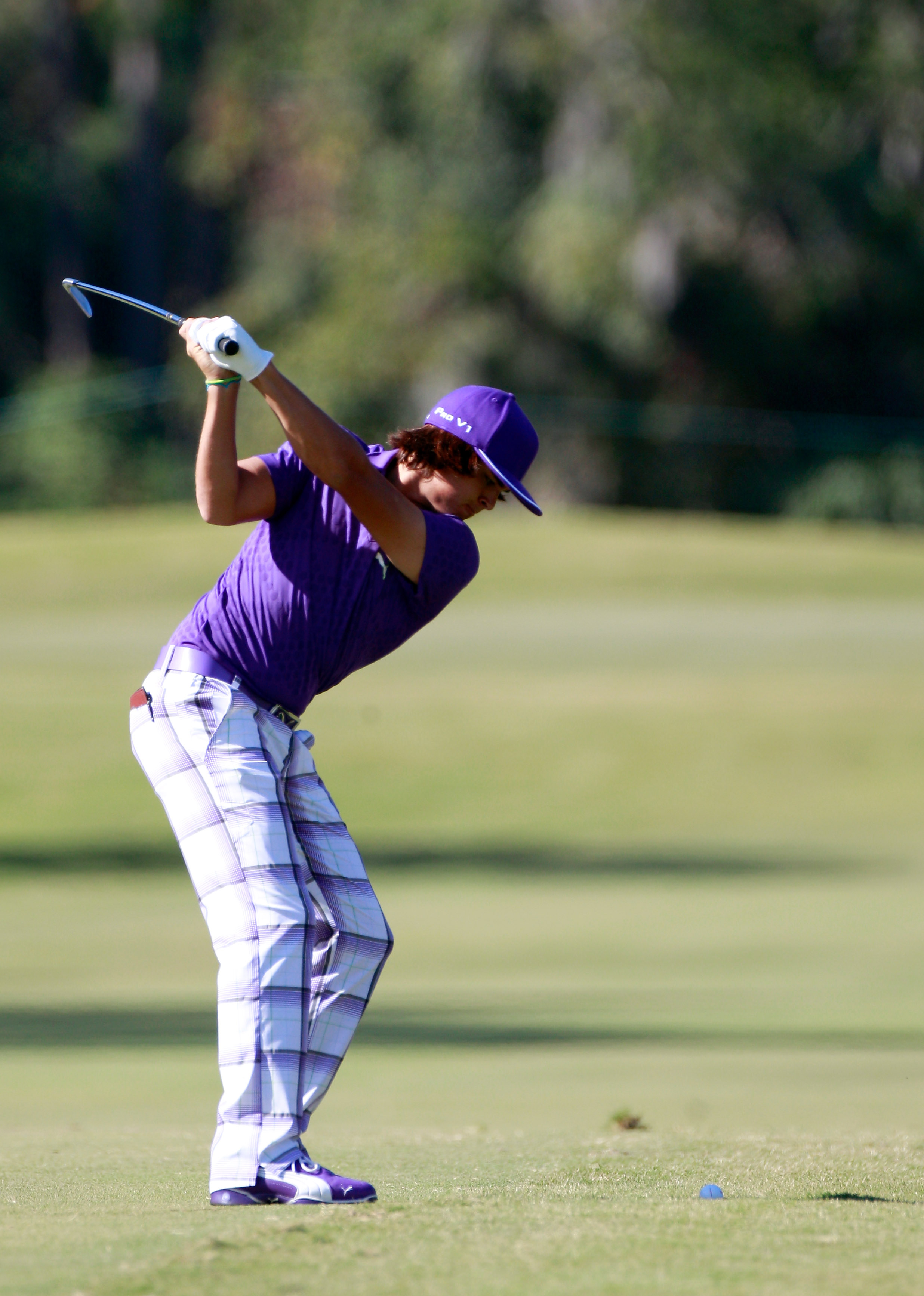 LAKE BUENA VISTA, FL - NOVEMBER 13:  Rickie Fowler hits a shot on the 1st hole during the third round of the Children's Miracle Network Classic at the Disney Palm and Magnolia course on November 13, 2010 in Lake Buena Vista, Florida.  (Photo by Sam Greenw