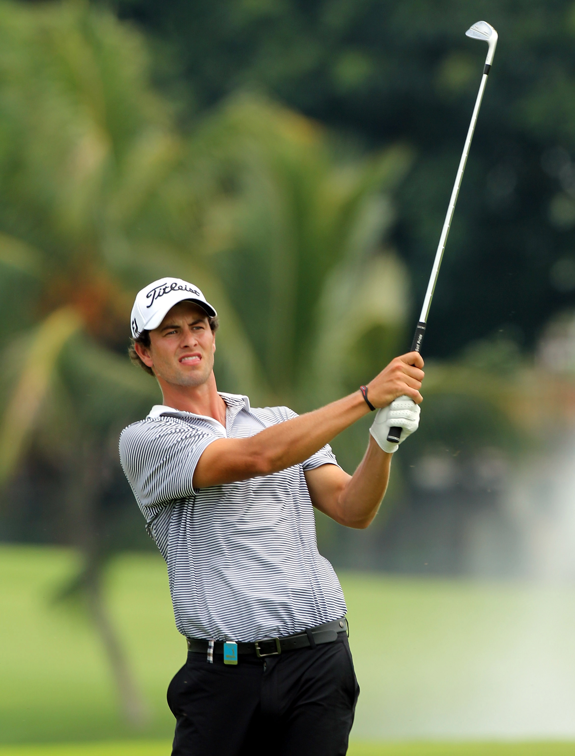 SINGAPORE - NOVEMBER 12:  Adam Scott of Australia plays his 2nd shot on the 5th hole during the second round of the Barclays Singapore Open held at the Sentosa Golf Club on November 12, 2010 in Singapore, Singapore.  (Photo by Stanley Chou/Getty Images)