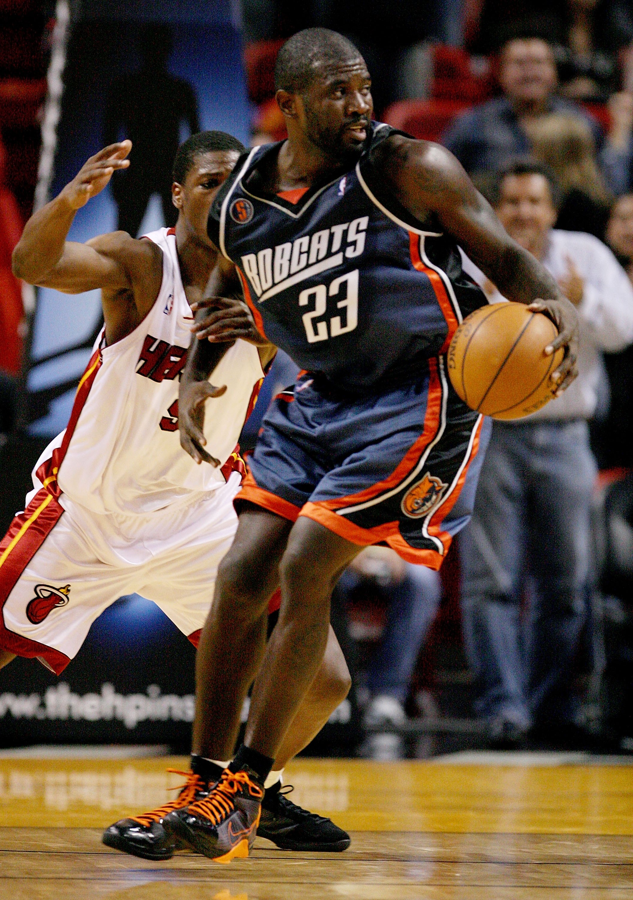 MIAMI - DECEMBER 08:  Jason Richardson #23 of the Charlotte Bobcats spins against Yakhouba Diawara #9 of the Miami Heat at American Airlines Arena on December 8, 2008 in Miami, Florida. The Heat defeated the Bobcats 100-96. NOTE TO USER: User expressly ac
