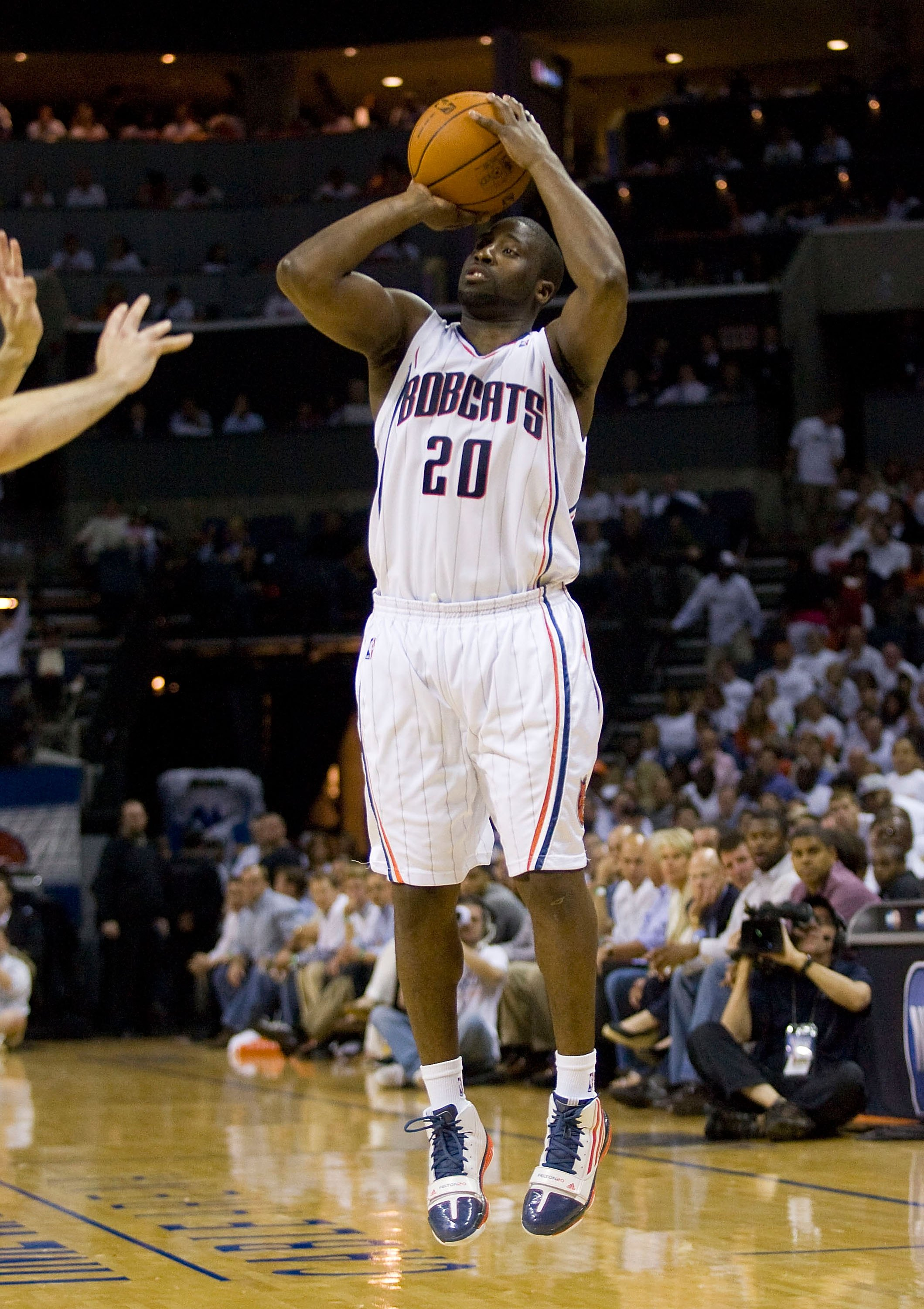 CHARLOTTE, NC - APRIL 26: Raymond Felton #20 of the Charlotte Bobcats attempts a jump shot against the Orlando Magic at Time Warner Cable Arena on April 26, 2010 in Charlotte, North Carolina.  The Magic defeated the Bobcats 99-90 to complete the four game