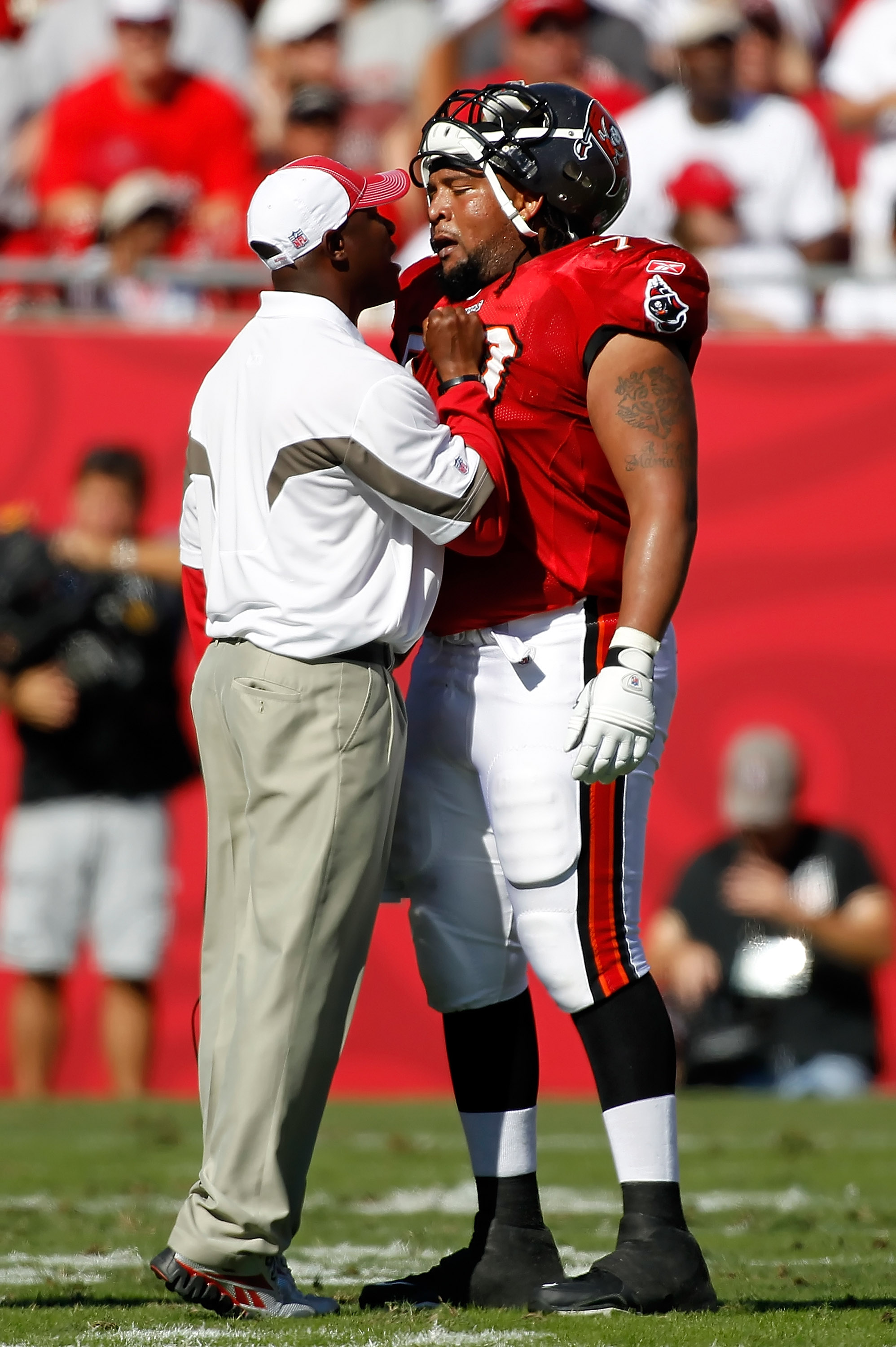 TAMPA, FL - NOVEMBER 14:  Head coach Raheem Morris of the Tampa Bay Buccaneers has some words for offensive lineman Donald Penn #70 during the game against the Carolina Panthers at Raymond James Stadium on November 14, 2010 in Tampa, Florida.  (Photo by J