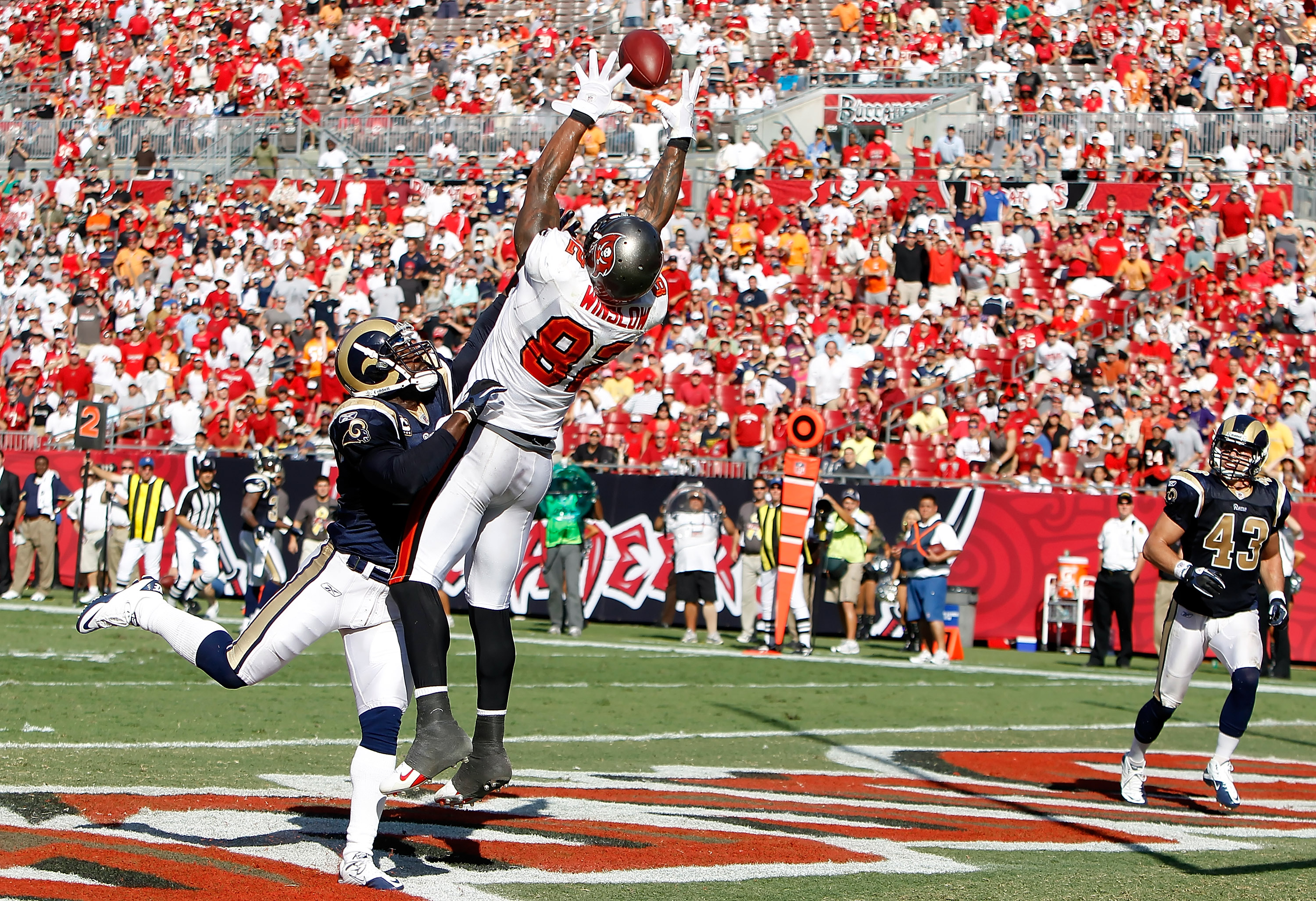 TAMPA, FL - OCTOBER 24:  Tightend Kellen Winslow #82 of the Tampa Bay Buccaneers cannot bring in this pass as safety Oshiomogho Atogwe #21 of the St. Louis Rams breaks it up during the game at Raymond James Stadium on October 24, 2010 in Tampa, Florida.