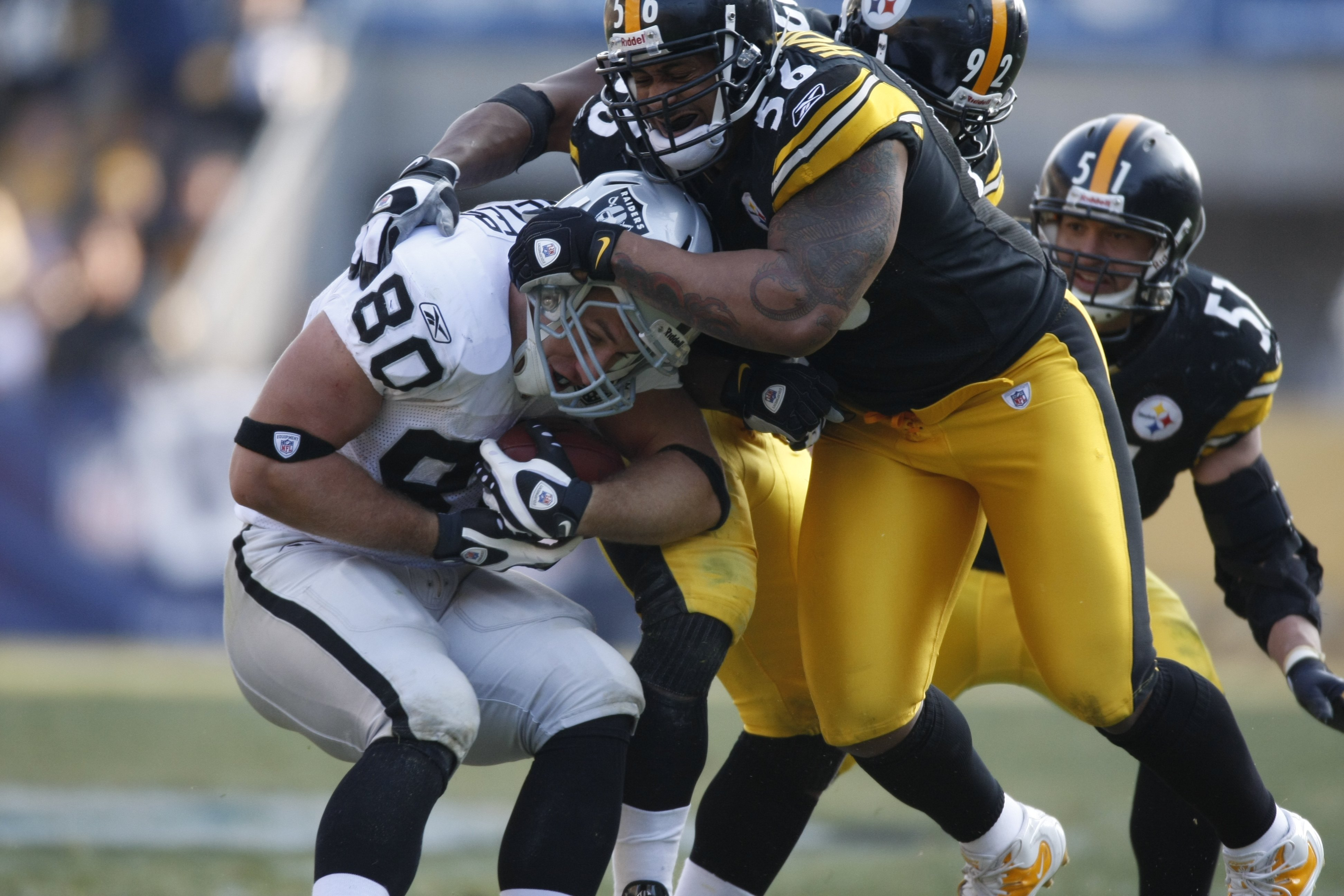 109f5991a67 PITTSBURGH - DECEMBER 06  LaMarr Woodley  56 of the Pittsburgh Steelers  tackles Zach Miller