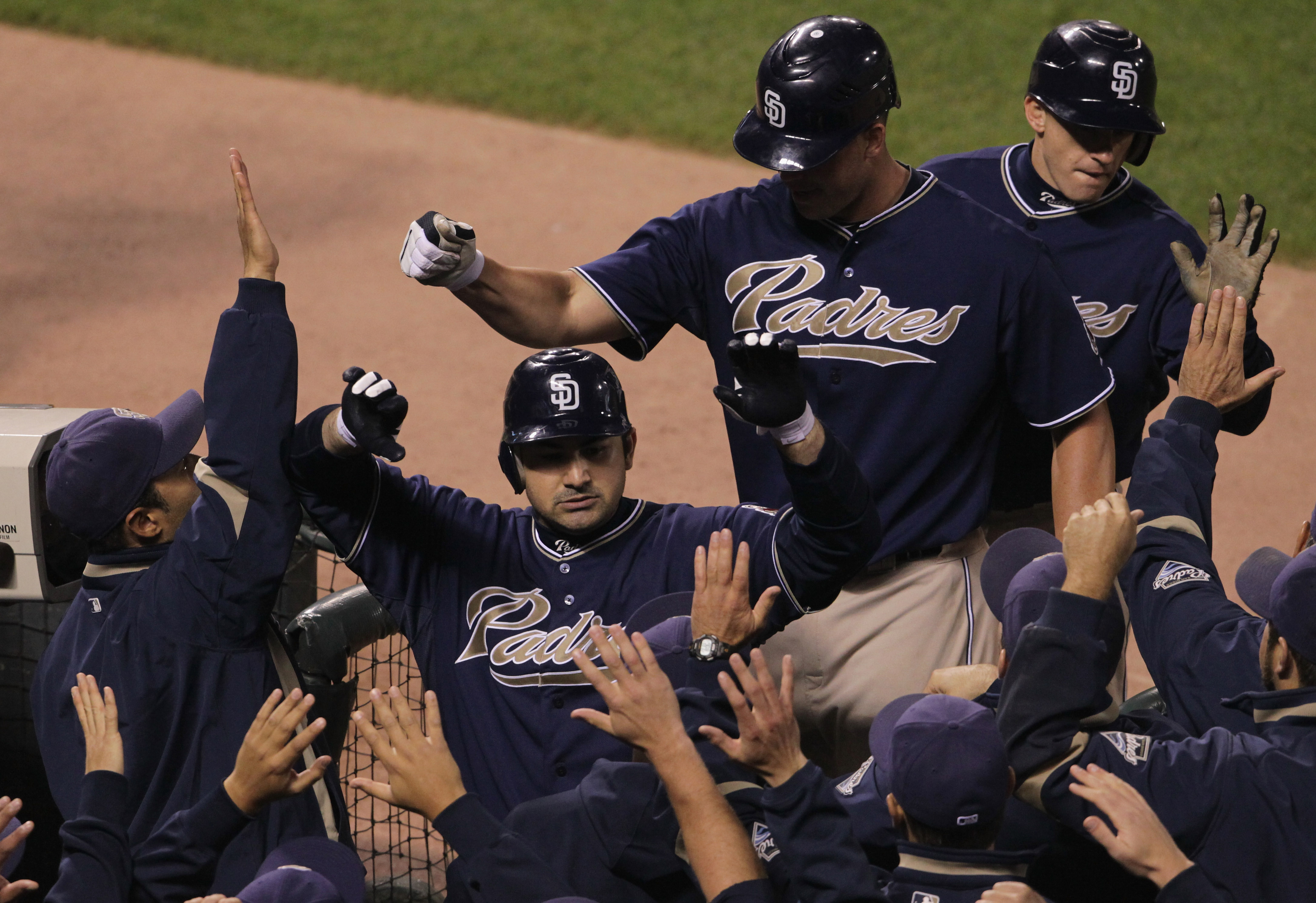 SAN FRANCISCO - OCTOBER 01:  Adrian Gonzalez #23 of the San Diego Padres is congratulated by teammates after hitting a three run home run during the third inning against the San Francisco Giants October 1, 2010 in San Francisco, California.  (Photo by Jus