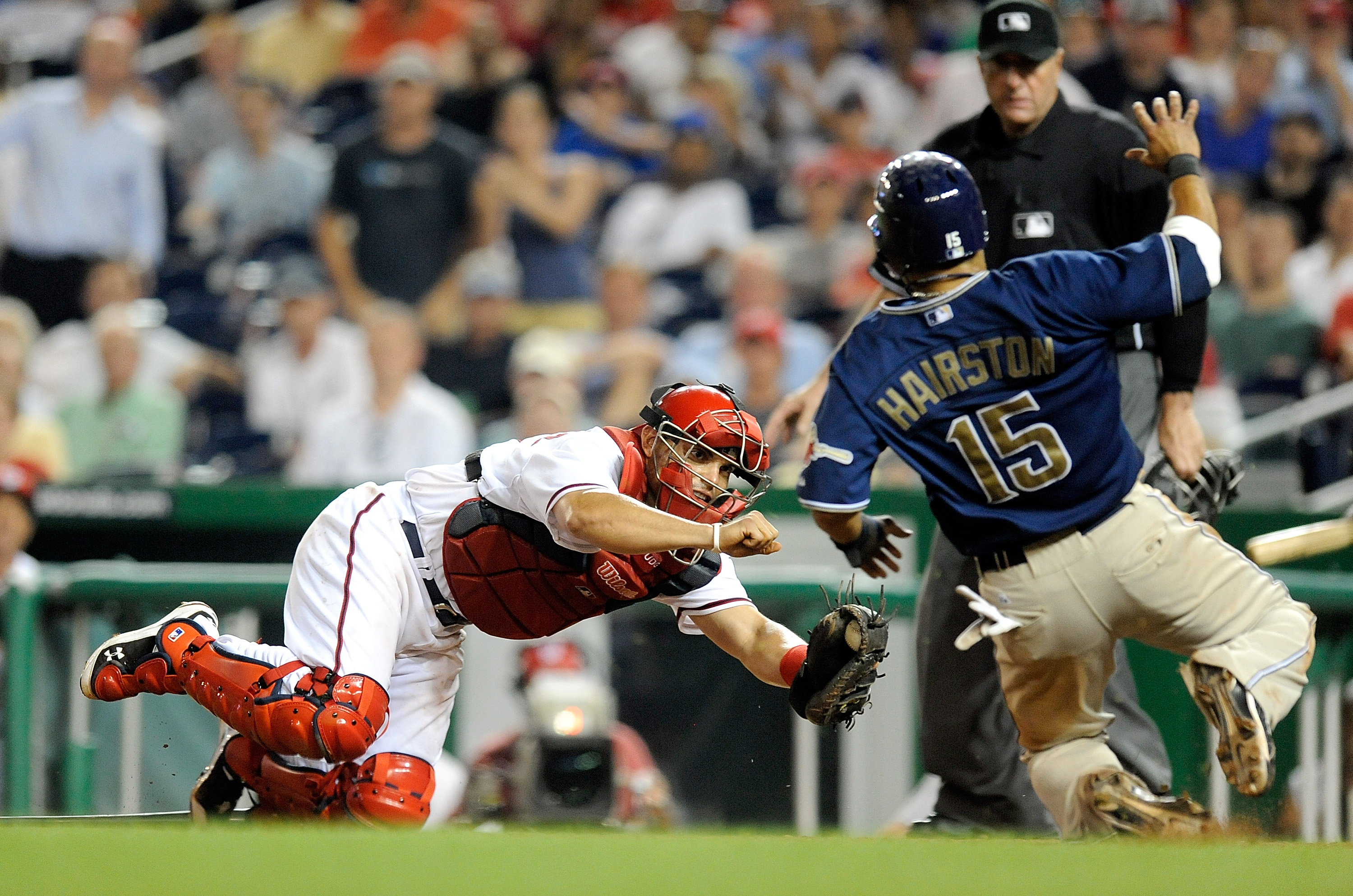 WASHINGTON - JULY 06:  Jerry Hairston Jr. #15 of the San Diego Padres is tagged out at home plate to end the ninth inning by Ivan Rodriguez #7 of the Washington Nationals at Nationals Park on July 6, 2010 in Washington, DC.  (Photo by Greg Fiume/Getty Ima