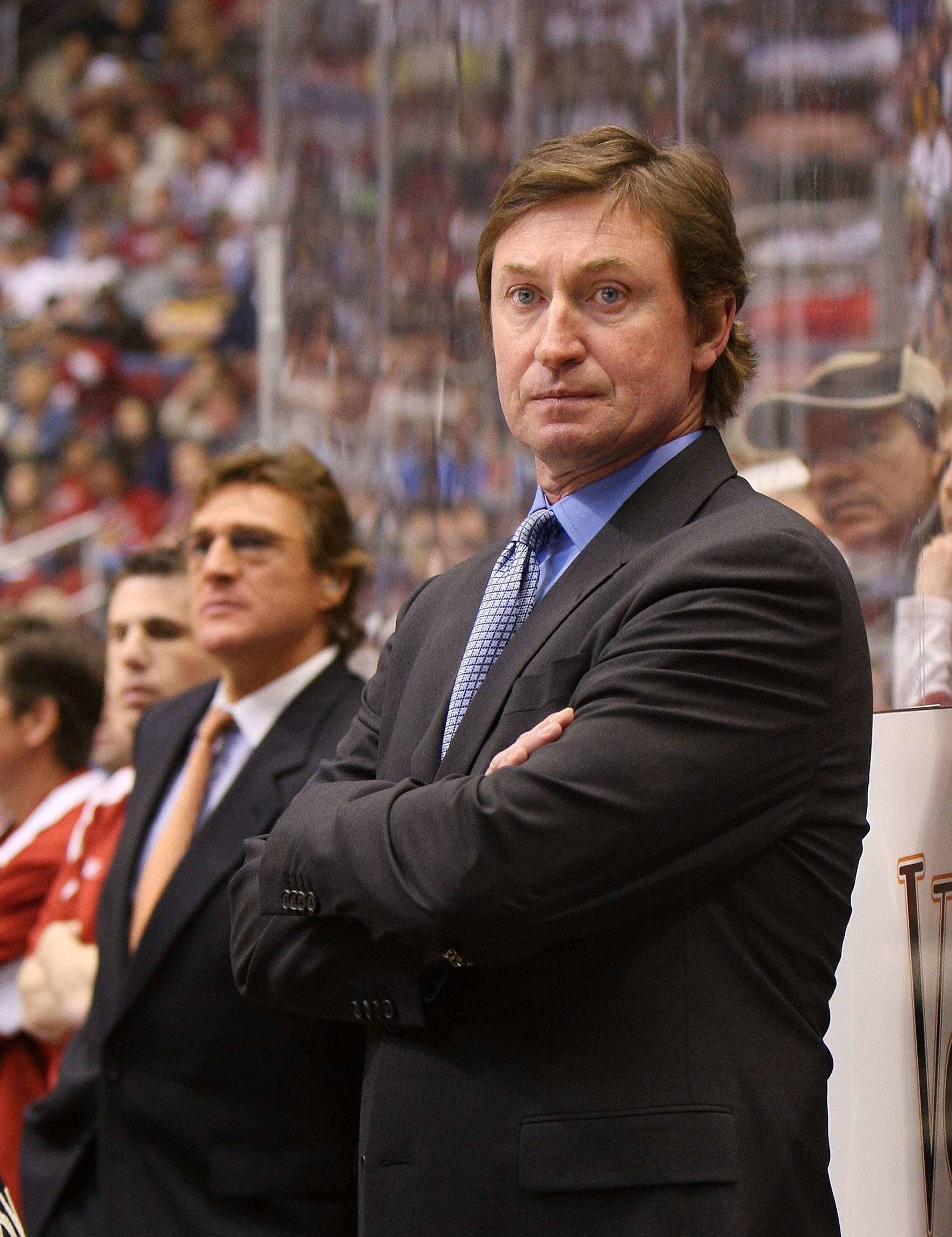 GLENDALE, AZ - FEBRUARY 28:  Head Coach Wayne Gretzky of the Phoenix Coyotes manages his team from behind the bench during his game against the St. Louis Blues on February 28, 2009 at the Jobing.com Arena in Glendale, Arizona.  (Photo by Bruce Bennett/Get