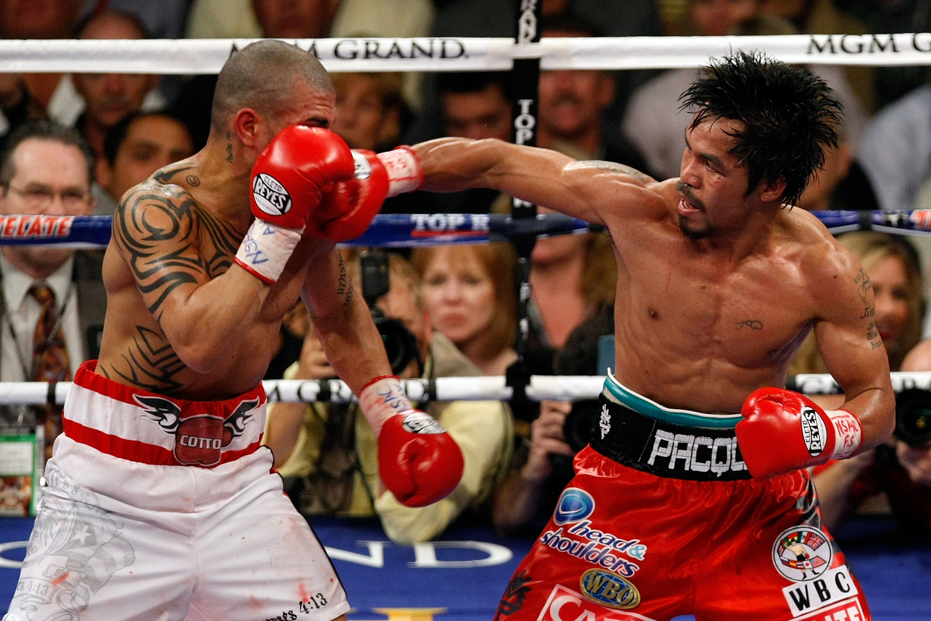 LAS VEGAS - NOVEMBER 14:  (R-L) Manny Pacquiao throws a right to the head of Miguel Cotto during their WBO welterweight title fight at the MGM Grand Garden Arena on November 14, 2009 in Las Vegas, Nevada. Pacquiao defeated Cotto by 12th round TKO.  (Photo