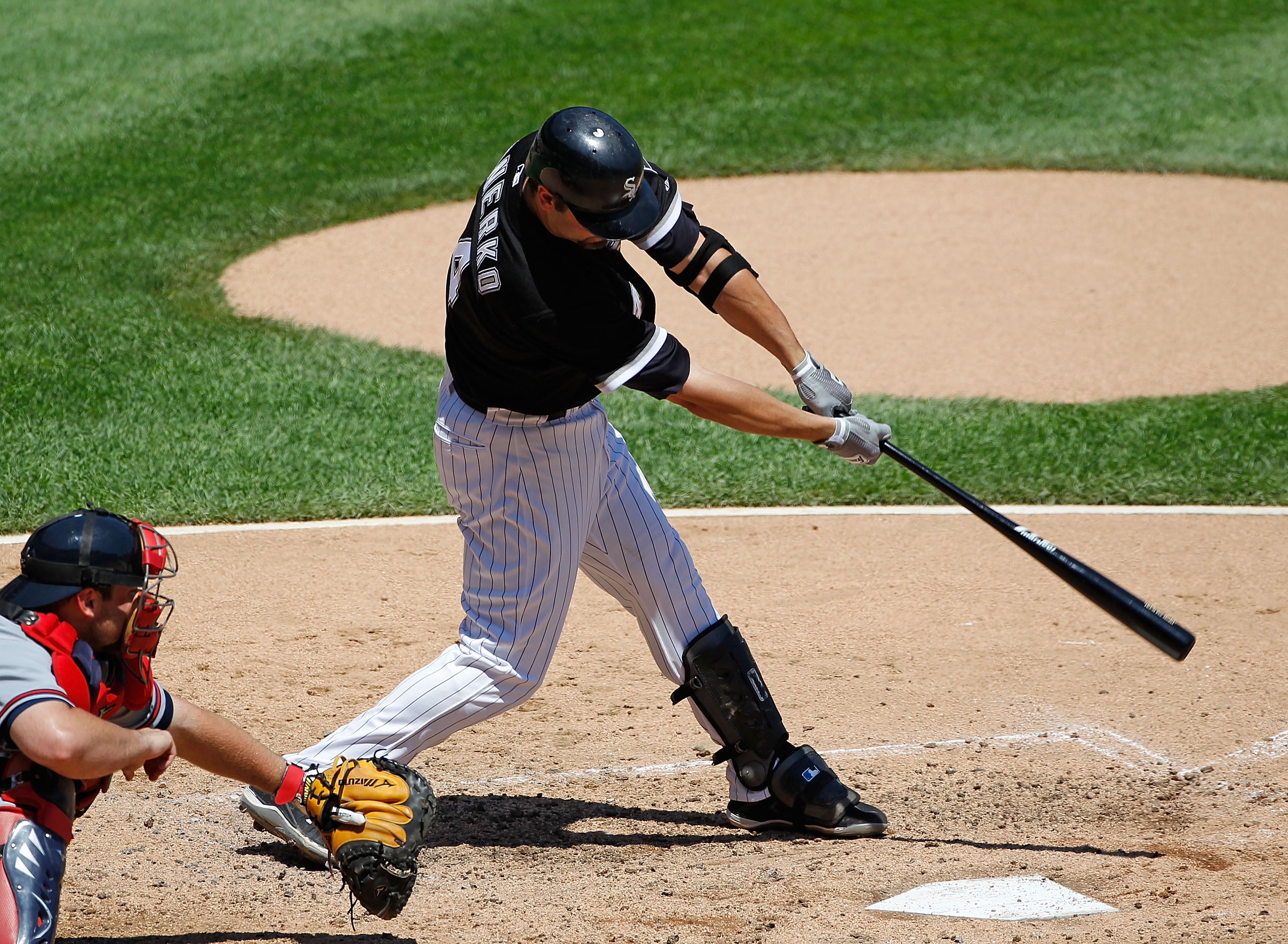 CHICAGO - JUNE 24: Paul Konerko #14 of the Chicago White Sox takes a swing against the Atlanta Braves at U.S. Cellular Field on June 24, 2010 in Chicago, Illinois. The White defeated the Braves 2-0.  (Photo by Jonathan Daniel/Getty Images)