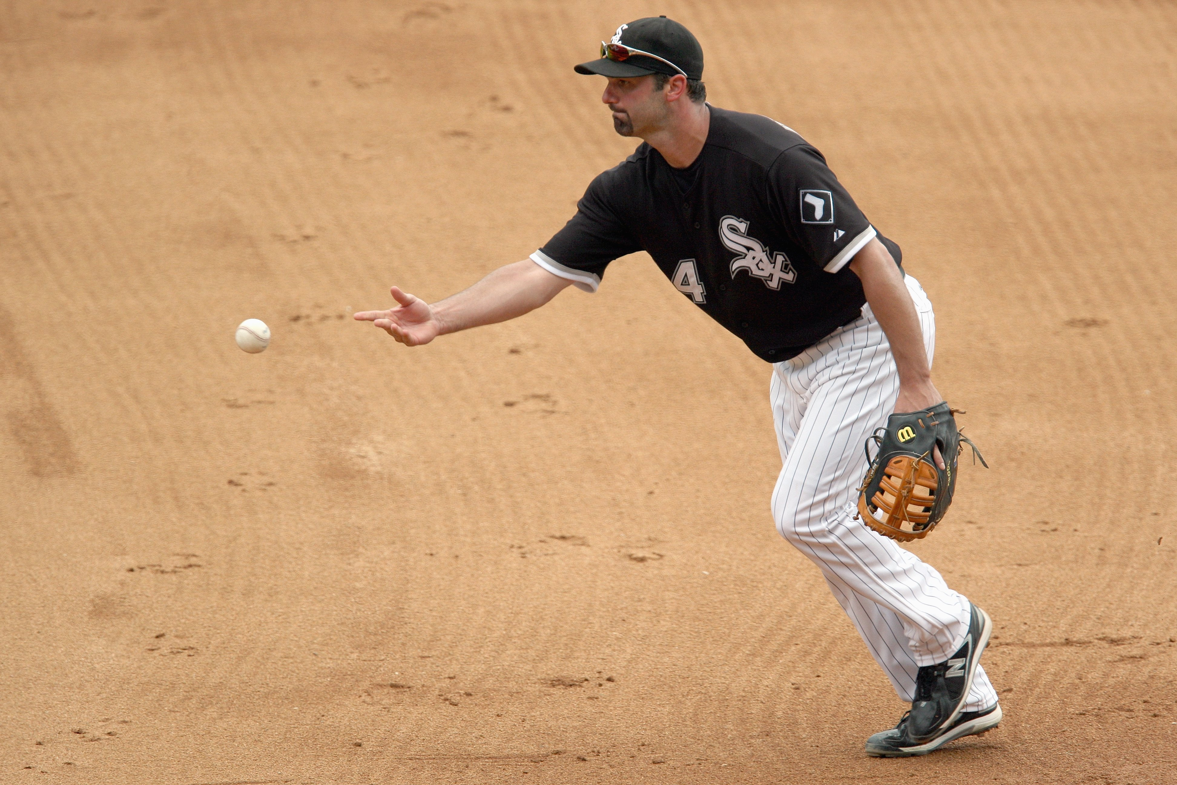 CHICAGO - AUGUST 23:  Paul Konerko #14 of the Chicago White Sox tosses the ball during the game against the Tampa Bay Rays on August 23, 2008 at U.S. Cellular Field in Chicago, Illinois. (Photo by Jonathan Daniel/Getty Images)