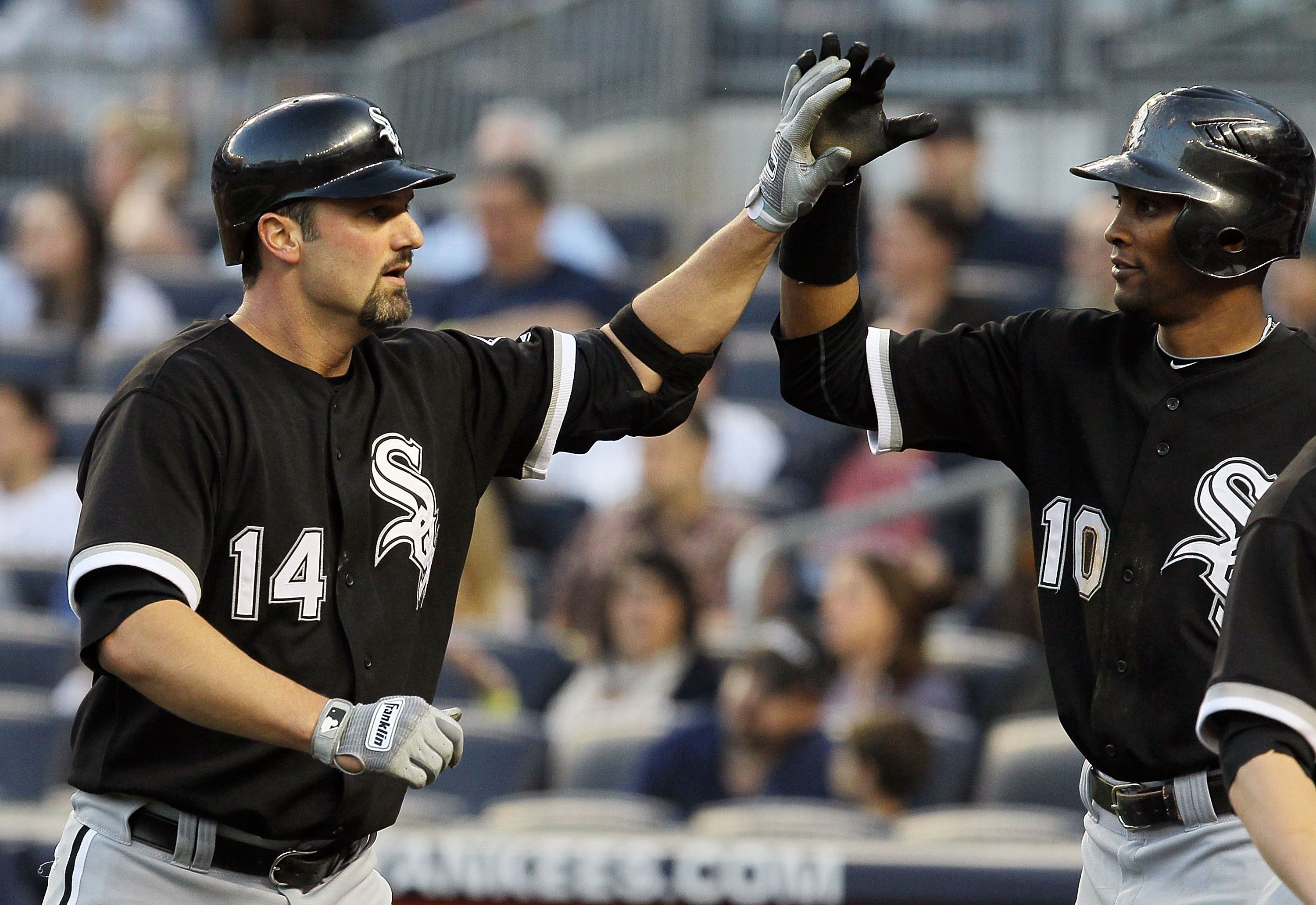 NEW YORK - APRIL 30:  Paul Konerko #14 of the Chicago White Sox celebrates his first inning three run home run against the New York Yankees with teammate Alexei Ramirez #10 on April 30, 2010 at Yankee Stadium in the Bronx borough of New York City.  (Photo