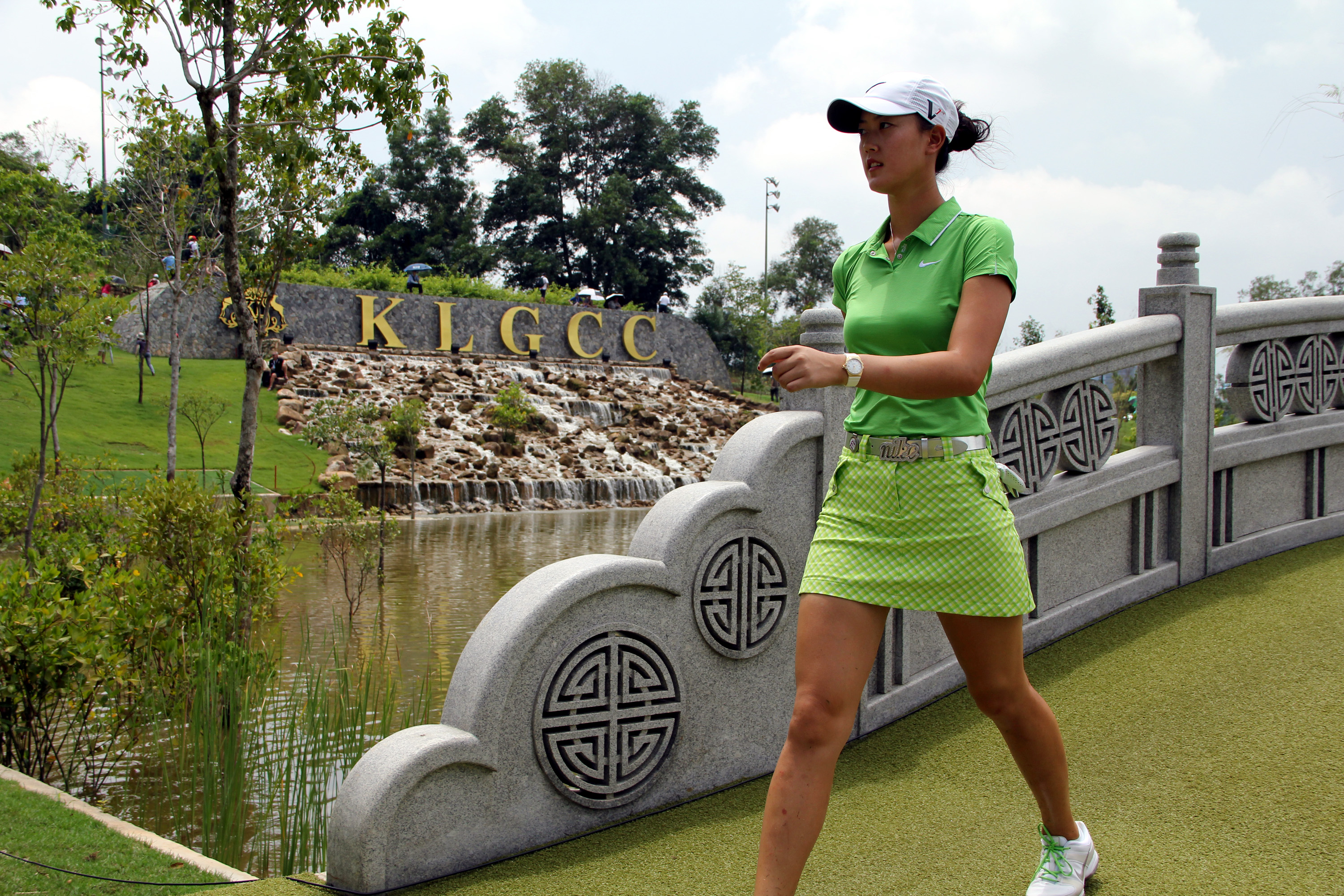 KUALA LUMPUR, MALAYSIA - OCTOBER 24:  Michelle Wie of USA walks across the bridge on the 15th hole during the Final Round of the Sime Darby LPGA on October 24, 2010 at the Kuala Lumpur Golf and Country Club in Kuala Lumpur, Malaysia. (Photo by Stanley Cho