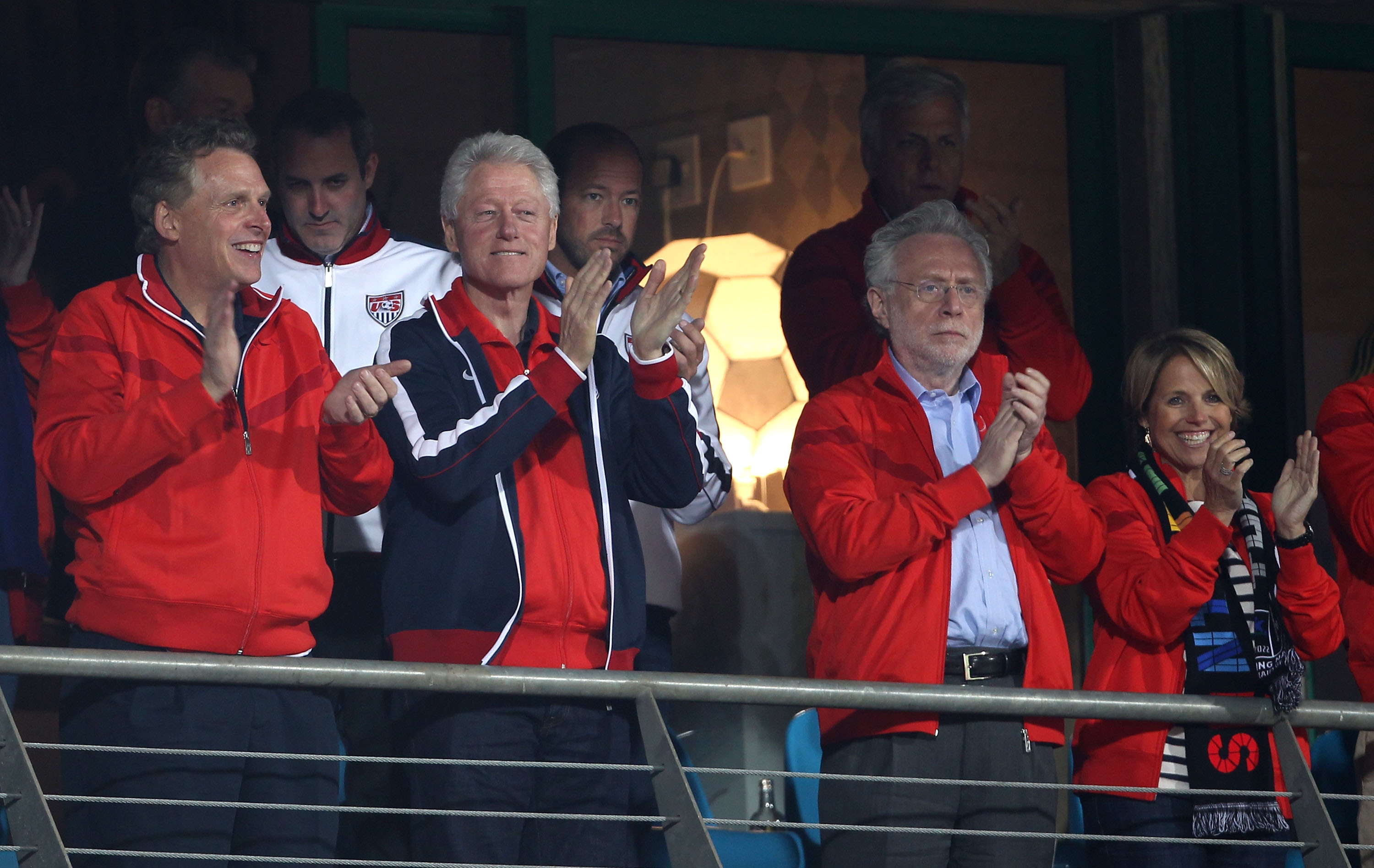 RUSTENBURG, SOUTH AFRICA - JUNE 26:  Former US President Bill Clinton stands for the national anthem with US news anchors Wolf Blitzer (2ndR) and Katie Couric (R) prior to the 2010 FIFA World Cup South Africa Round of Sixteen match between USA and Ghana a