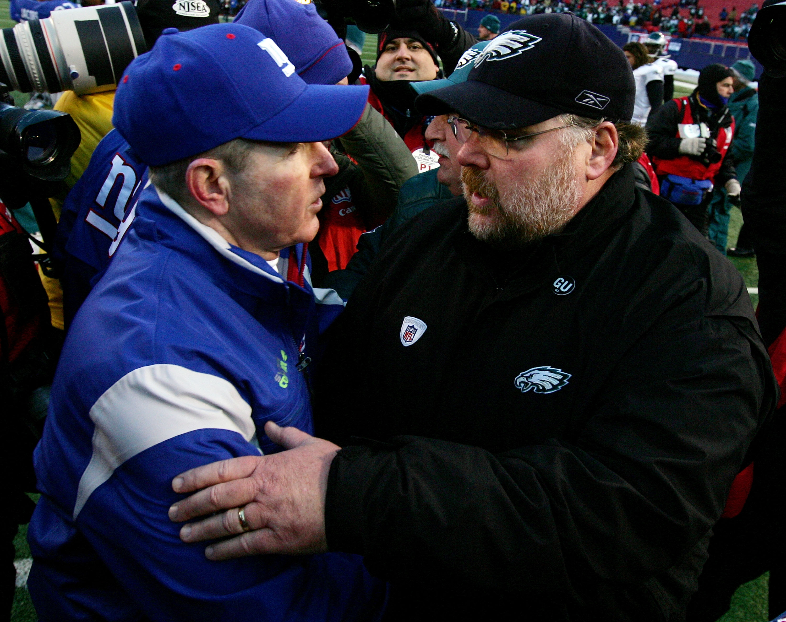 EAST RUTHERFORD, NJ - JANUARY 11:  Head coach Tom Coughlin #10 of the New York Giants shakes hands with head coach Andy Reid of the Philadelphia Eagles after the NFC Divisional Playoff Game on January 11, 2009 at Giants Stadium in East Rutherford, New Jer