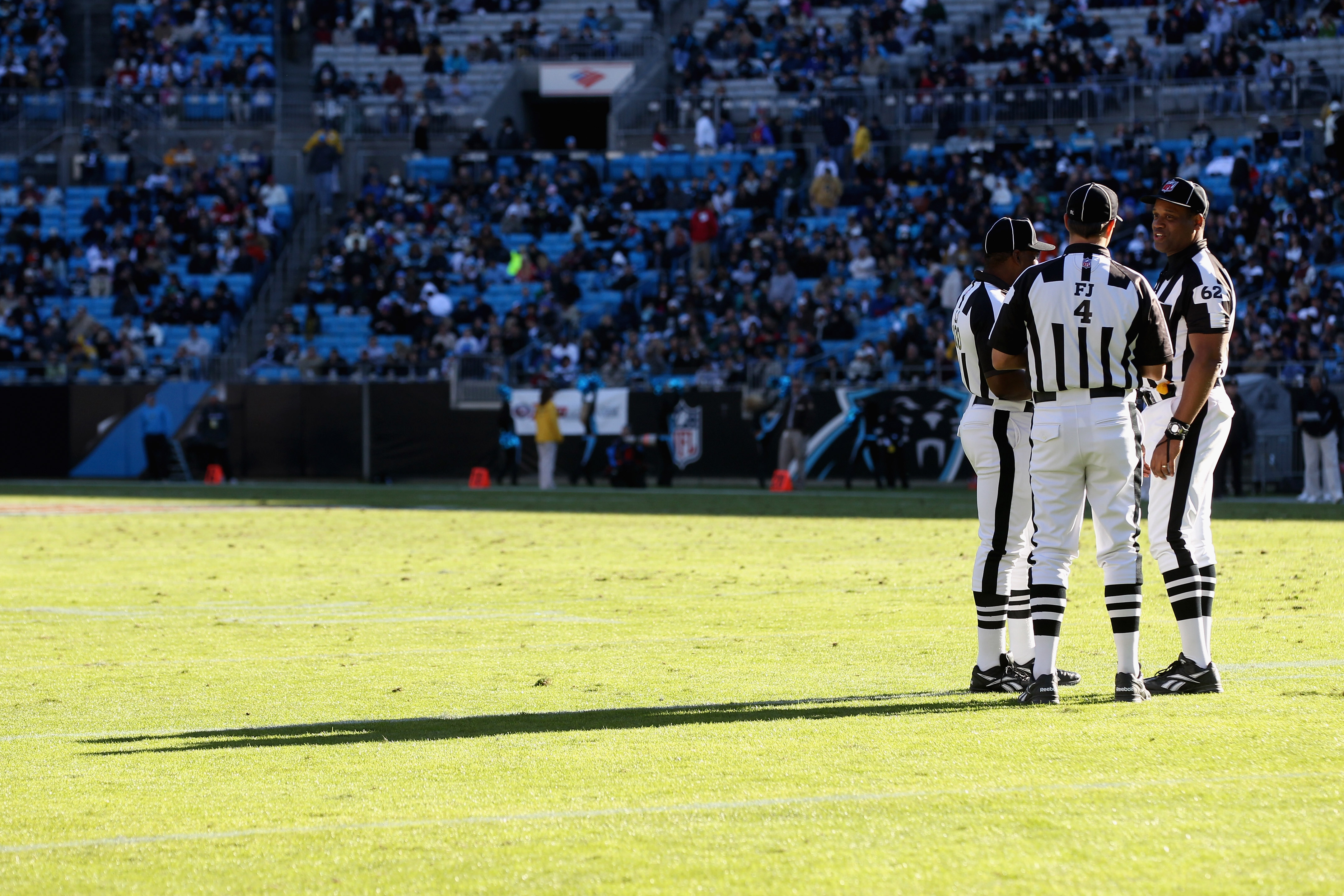 CHARLOTTE, NC - NOVEMBER 07:  A group of referees huddle during their game between the New Orleans Saints and the Carolina Panthers during their game at Bank of America Stadium on November 7, 2010 in Charlotte, North Carolina.  (Photo by Streeter Lecka/Ge