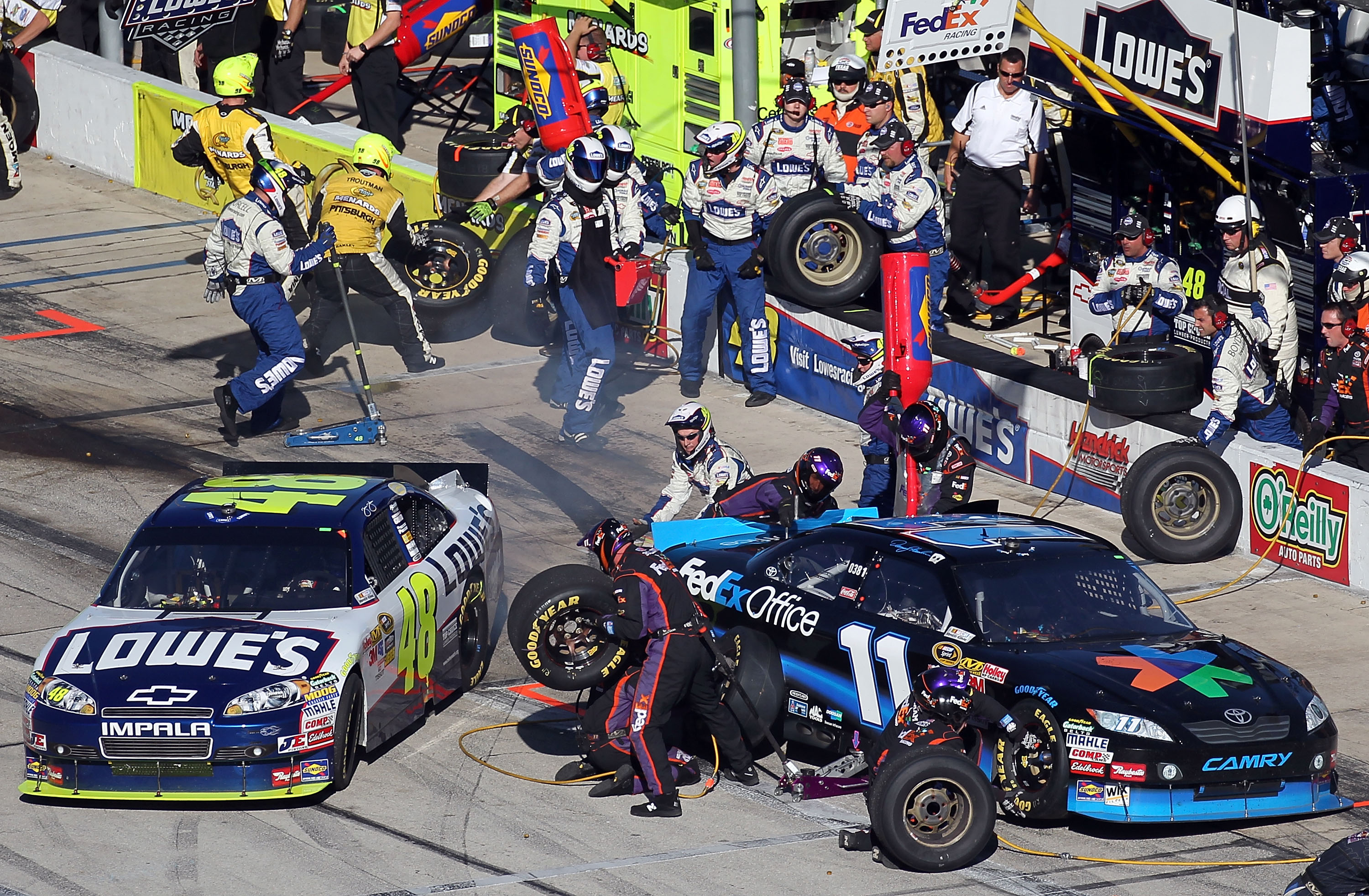 Jimmie Johnson and Denny Hamlin's NASCAR TItle battle ramped up when Mike Ford chose the pit stall directly in front of the No. 48.