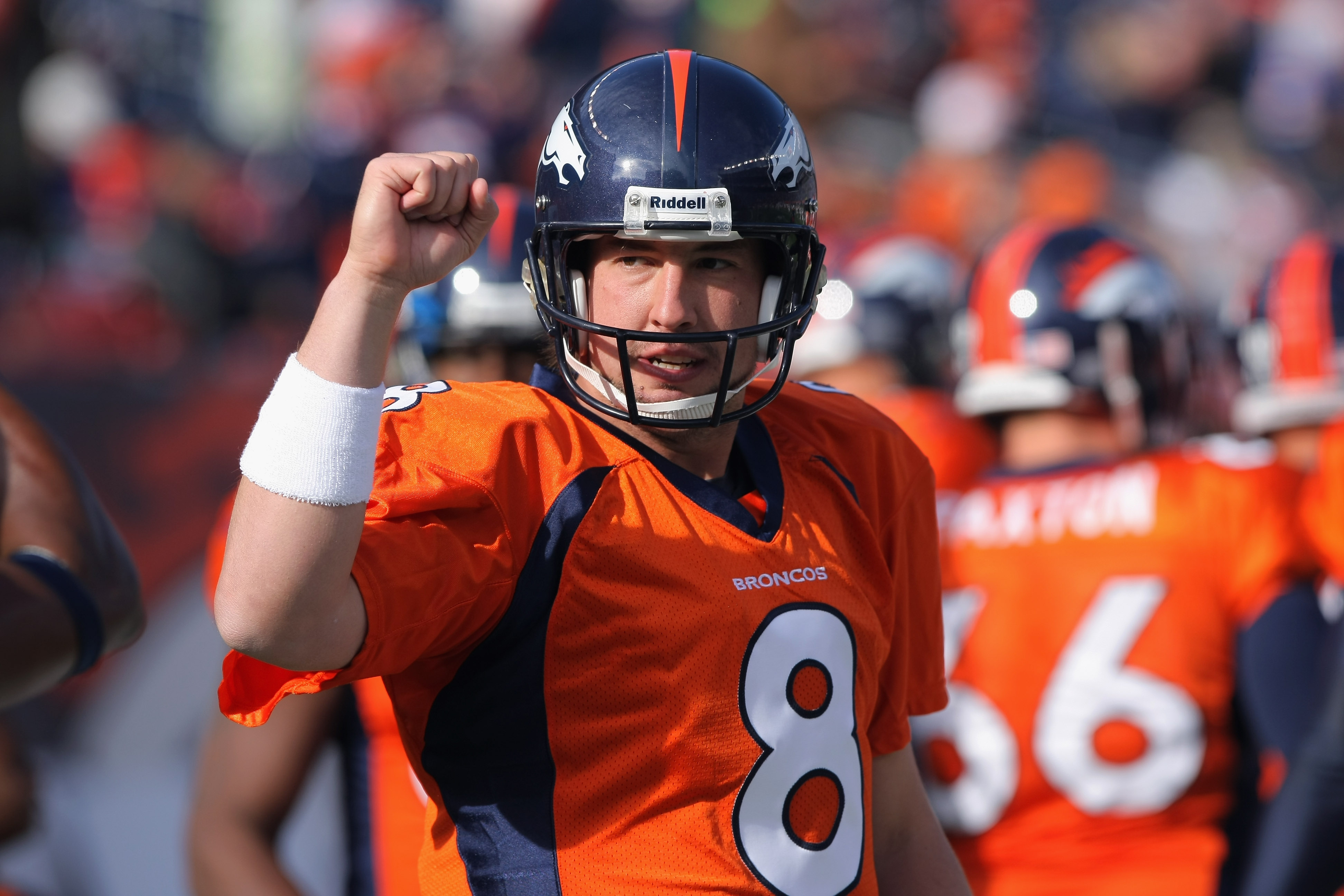 DENVER - NOVEMBER 14:  Quarterback Kyle Orton #8 of the Denver Broncos greets his teammates as they enter the field to face the Kansas City Chiefs at INVESCO Field at Mile High on November 14, 2010 in Denver, Colorado. The Broncos defeated the Chiefs 49-2