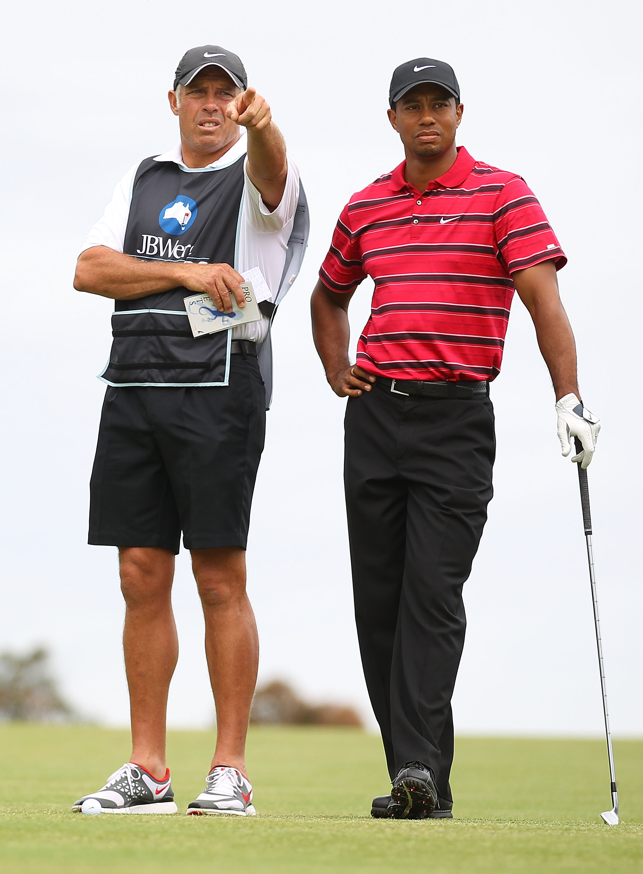MELBOURNE, AUSTRALIA - NOVEMBER 14:  Tiger Woods of the USA talks with his caddy Steve Williams during day four of the Australian Masters at The Victoria Golf Club on November 14, 2010 in Melbourne, Australia.  (Photo by Robert Cianflone/Getty Images)