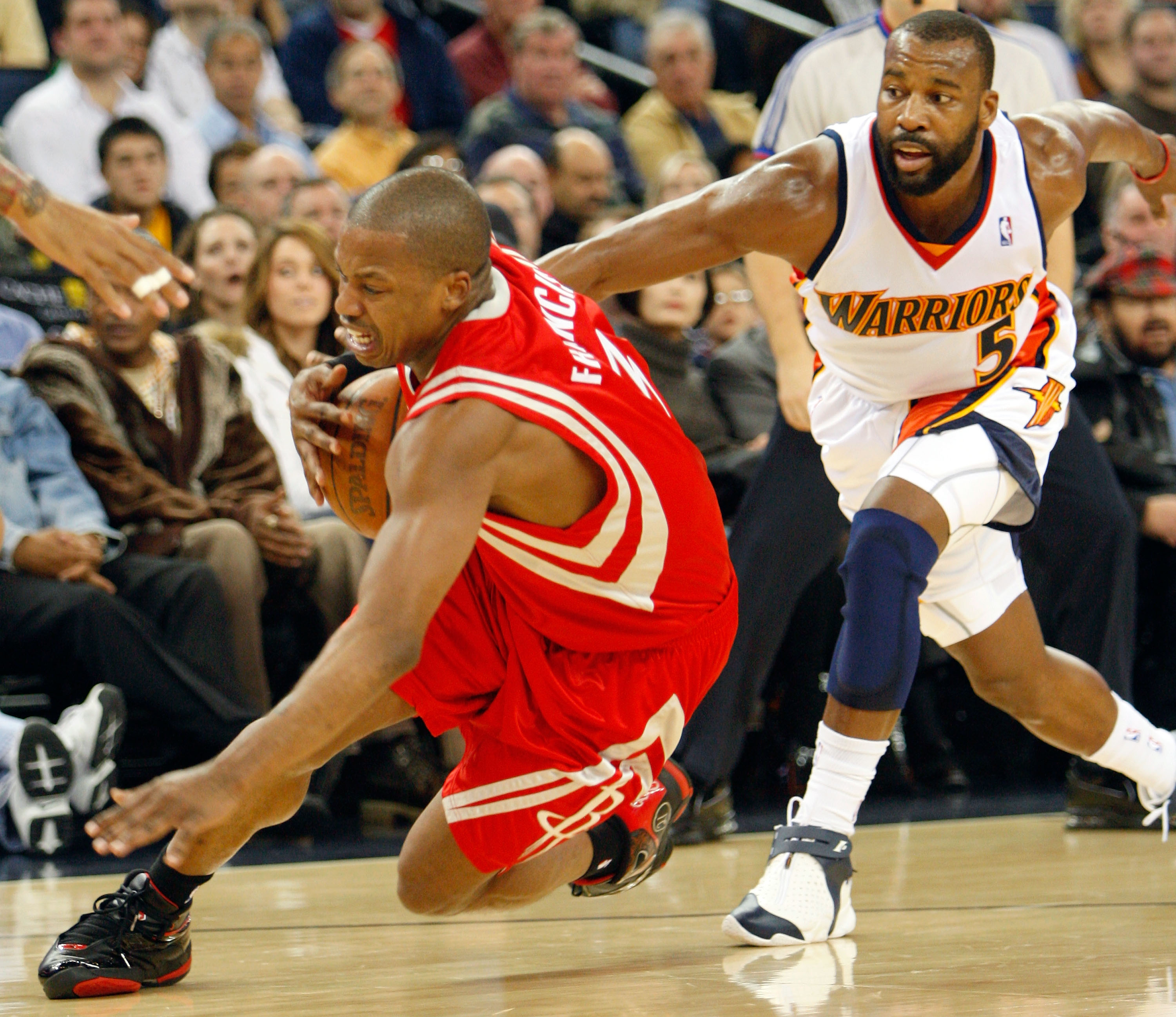 OAKLAND, CA - NOVEMBER 29:  Steve Francis #3 of the Houston Rockets stumbles as Baron Davis #5 of the Golden State Warriors defends during first-half action November 29, 2007 at the Oracle Arena in Oakland, California.  (Photo by Justin Sullivan/Getty Ima