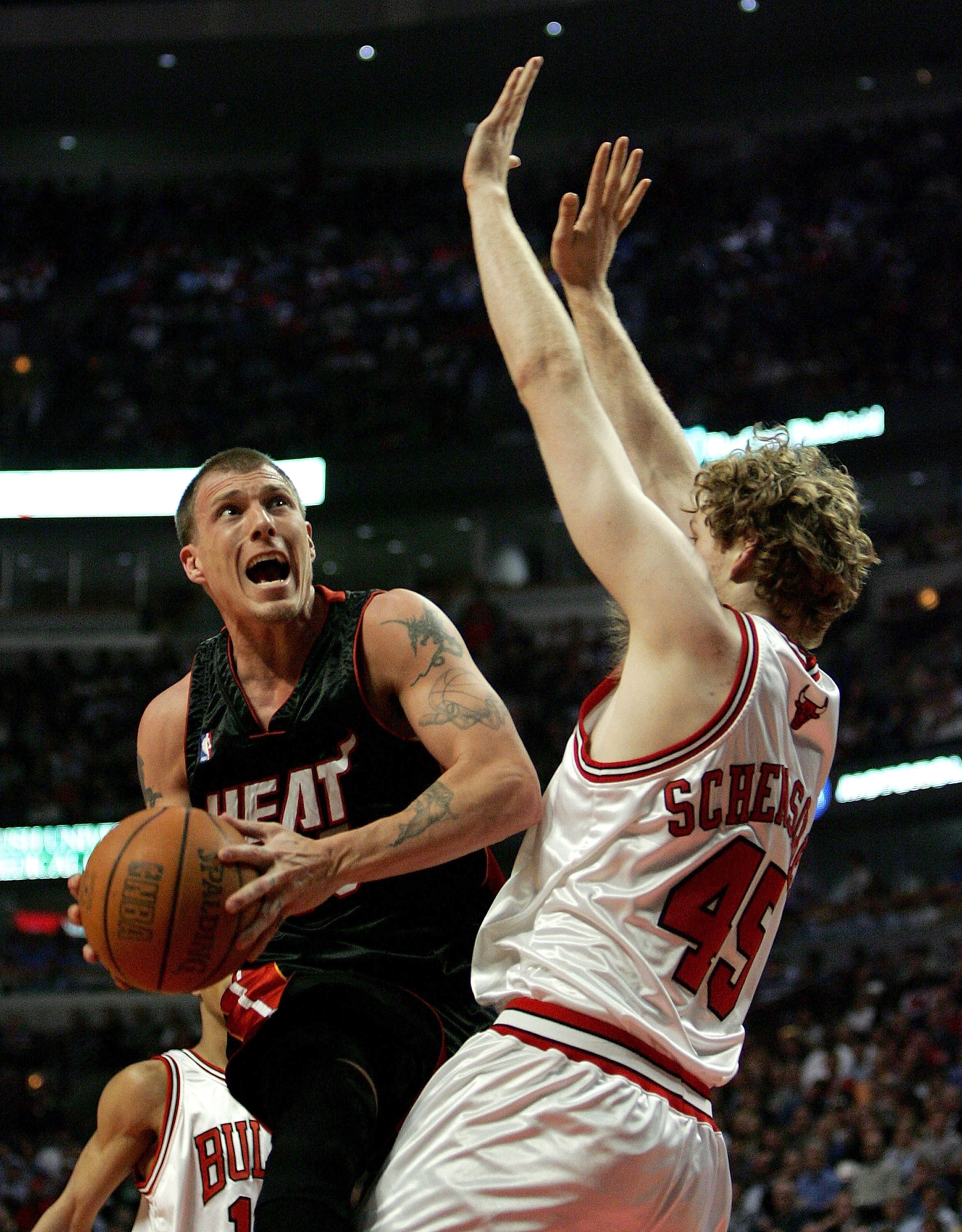 CHICAGO - APRIL 27:  Jason Williams #55 of the Miami Heat puts up a shot against Luke Schensher #45 of the Chicago Bulls in game three of the Eastern Conference Quarterfinals during the 2006 NBA Playoffs on April 27, 2006 at the United Center in Chicago,
