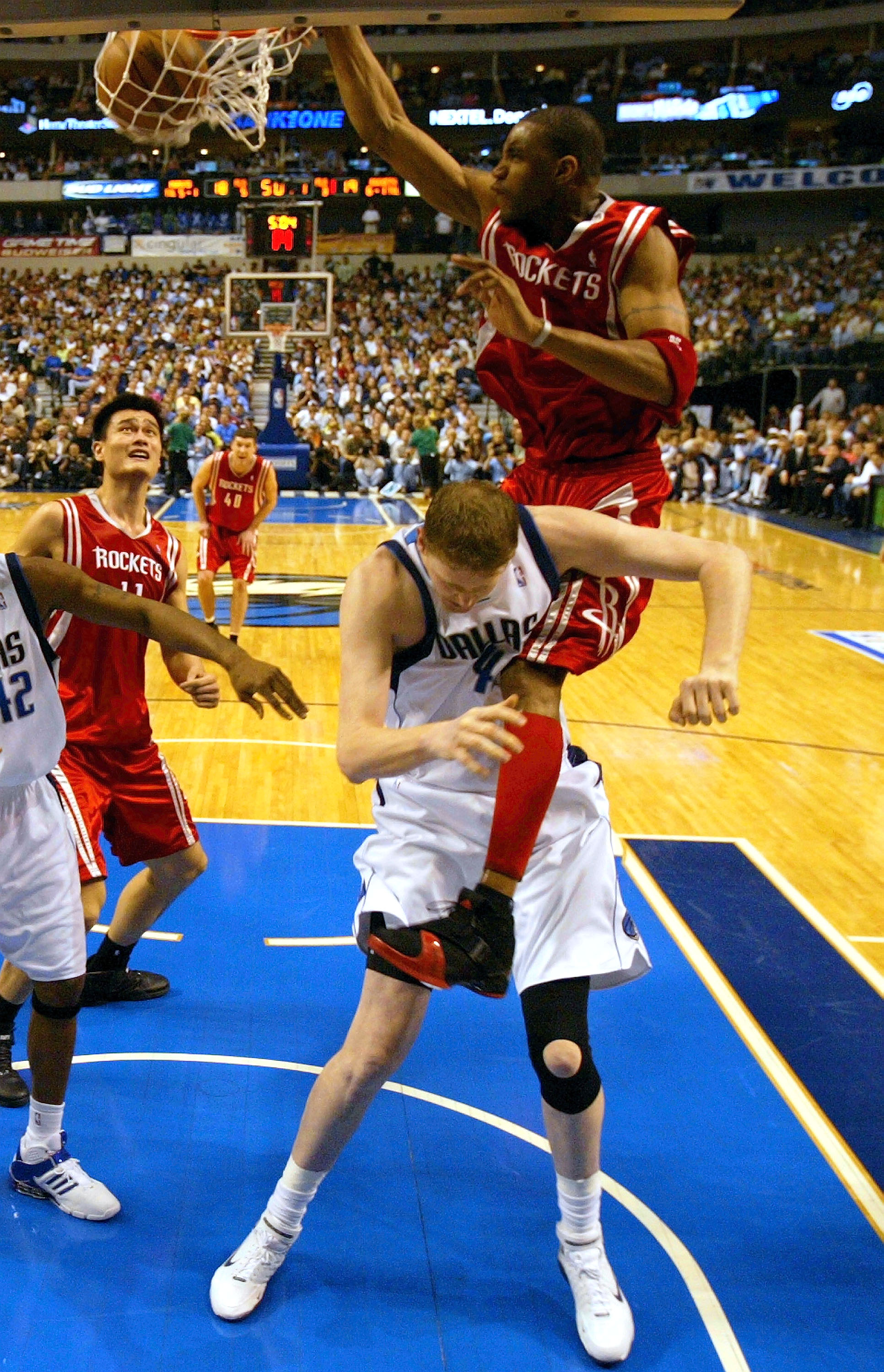DALLAS - APRIL 25:  Forward Tracy McGrady #1 of the Houston Rockets makes the slam dunk on top of Shawn Bradley #44 of the Dallas Mavericks in Game two of the Western Conference Quarterfinals during the 2005 NBA Playoffs on April 25, 2005 at the American