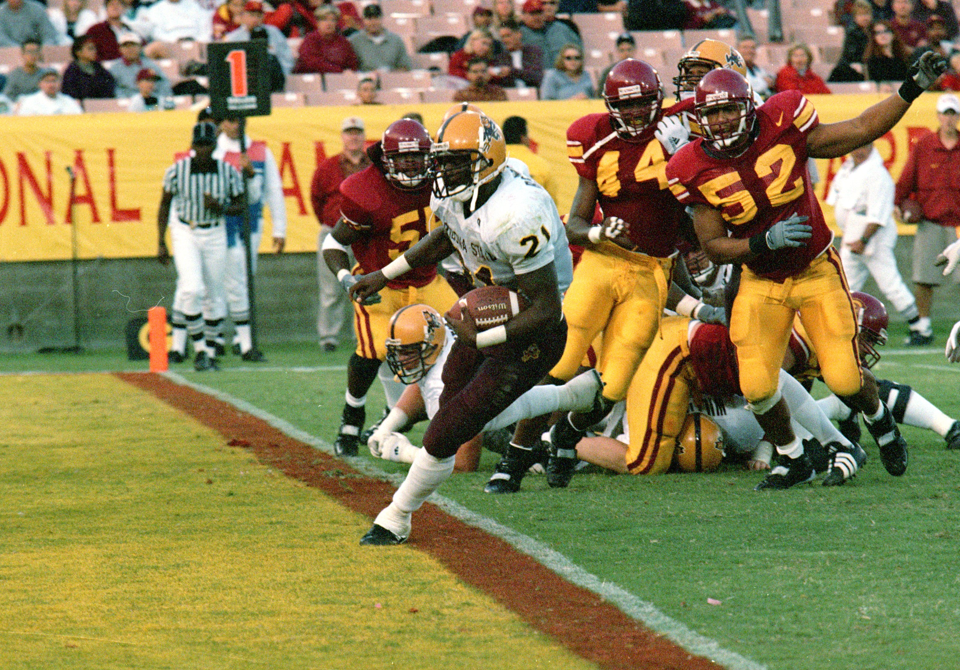6 Nov 1999:  J.R Redmond #21 of the Arizona State Sun Devils carries the ball in for a touchdown during the game against the USC Trojans at the LA Coliseum in Los Angeles, California. The Sun Devils defeated the Trojans 26-16. Mandatory Credit: Steve Gray
