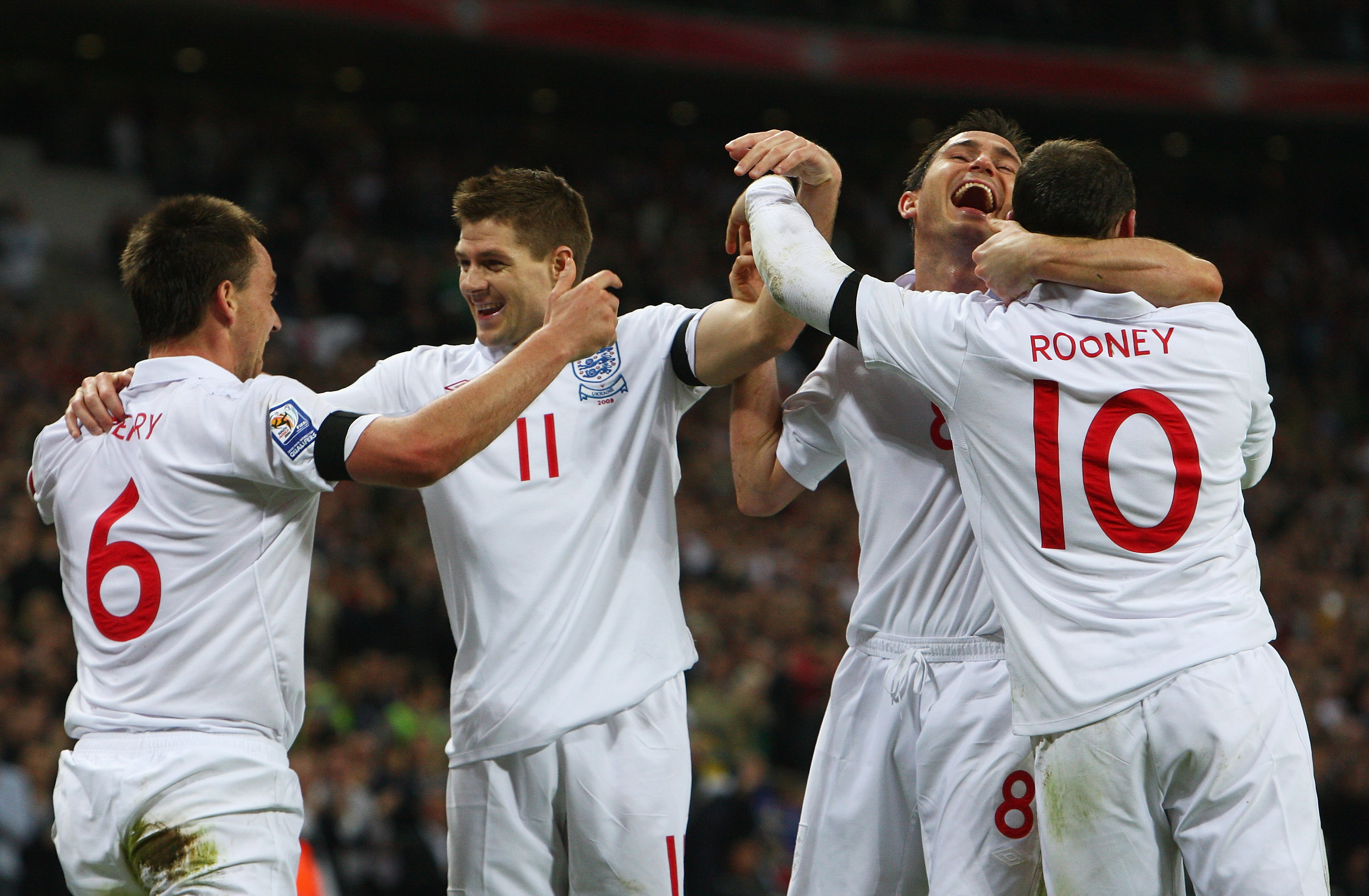 LONDON - APRIL 01:  John Terry (L) of England celebrates scoring his goal with Steven Gerrard, Frank Lampard and Wayne Rooney during the FIFA 2010 World Cup Group 6 Qualifying match between England and Ukraine at Wembley Stadium on April 1, 2009 in London