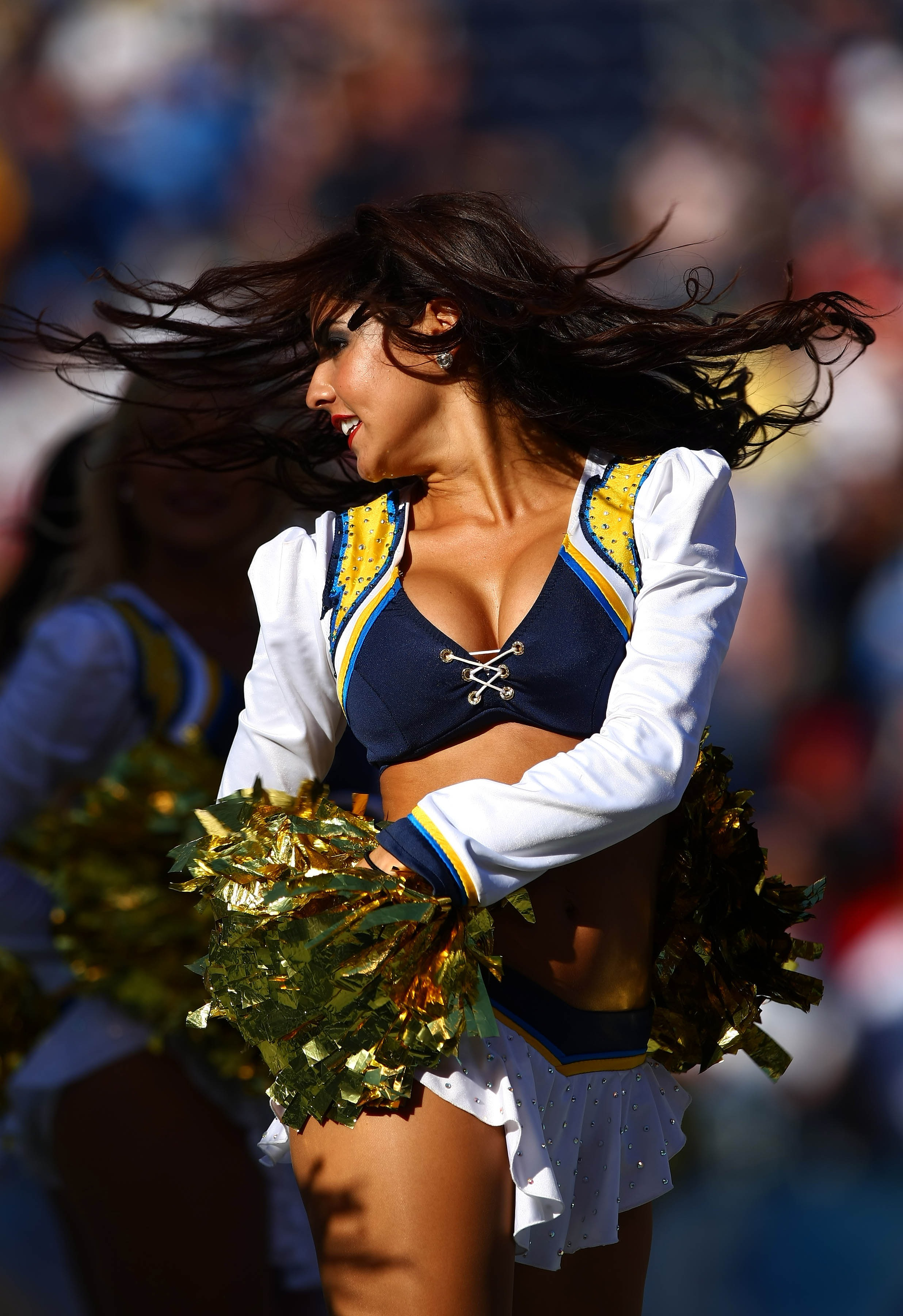 SAN DIEGO, UNITED STATES - SEPTEMBER 30: A Cheerleader from the San Diego Chargers performs a dance routine during their NFL game on September 30, 2007 at Qualcomm Stadium in San Diego, California.  (Photo by Donald Miralle/Getty Images)