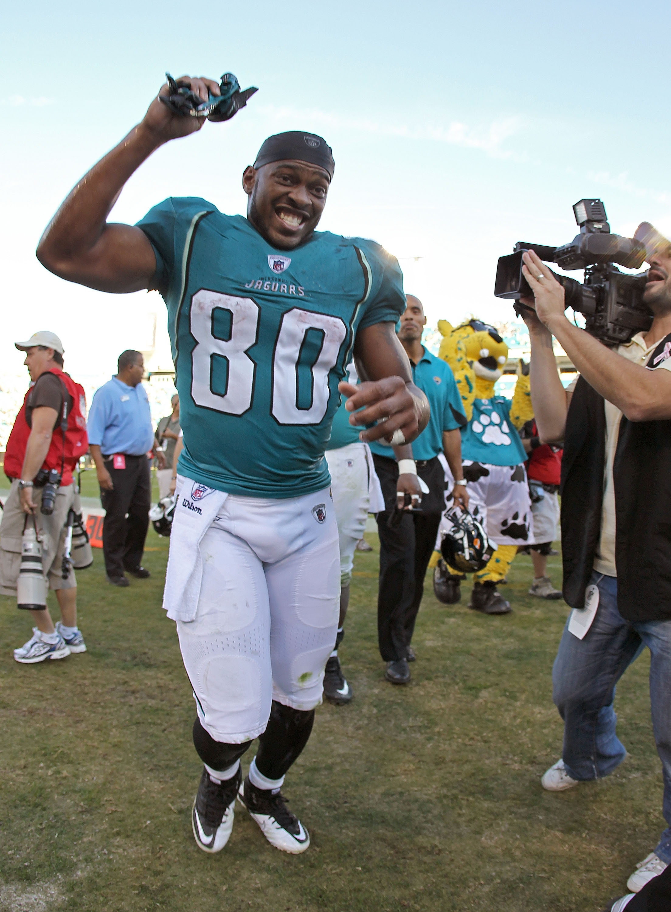 JACKSONVILLE, FL - NOVEMBER 14: Mike Thomas #80 of the Jacksonville Jaguars walks off the field after winning a game against the Houston Texans at EverBank Field on November 14, 2010 in Jacksonville, Florida.  (Photo by Mike Ehrmann/Getty Images)