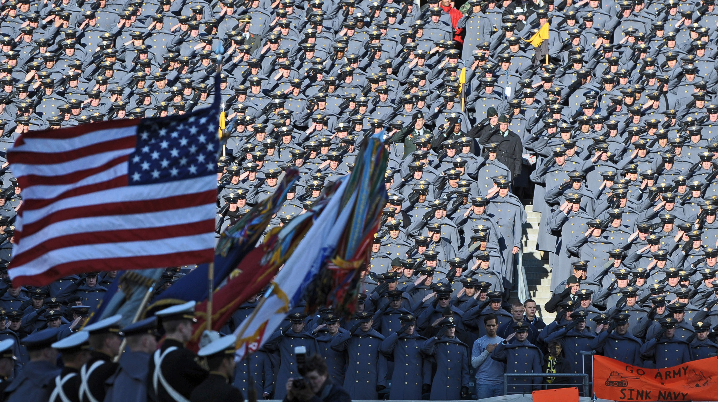 PHILADELPHIA - DECEMBER 12:  Army Cadets salute the American Flag during the National Anthem before the game against the Navy Midshipmen on December 12, 2009 at Lincoln Financial Field in Philadelphia, Pennsylvania. (Photo by Drew Hallowell/Getty Images)