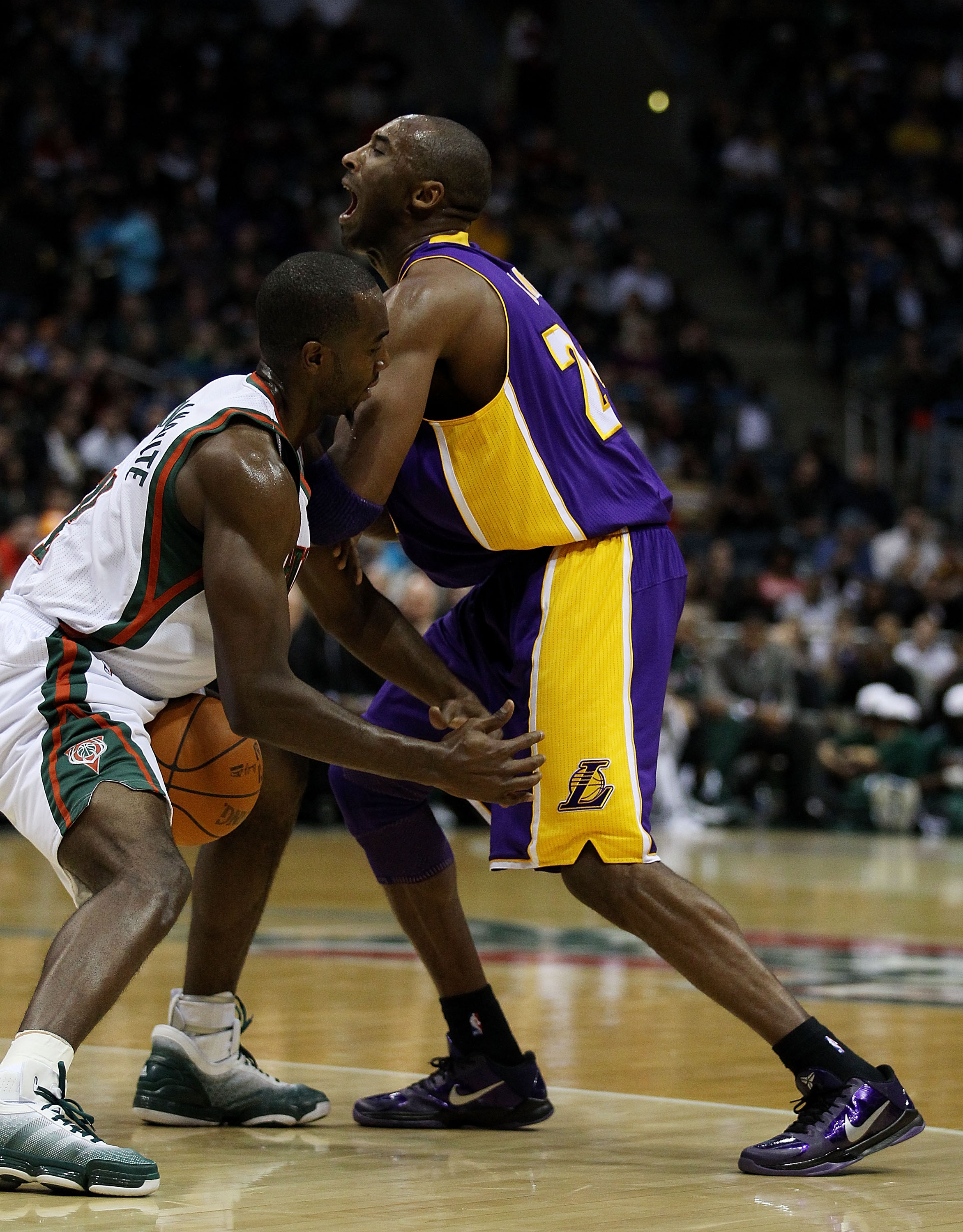 MILWAUKEE - NOVEMBER 16: Luc Richard Mbah a Moute #12 of the Milwaukee Bucks strips the ball from Kobe Bryant #24 of the Los Angeles Lakers at the Bradley Center on November 16, 2010 in Milwaukee, Wisconsin. NOTE TO USER: User expressly acknowledges and a
