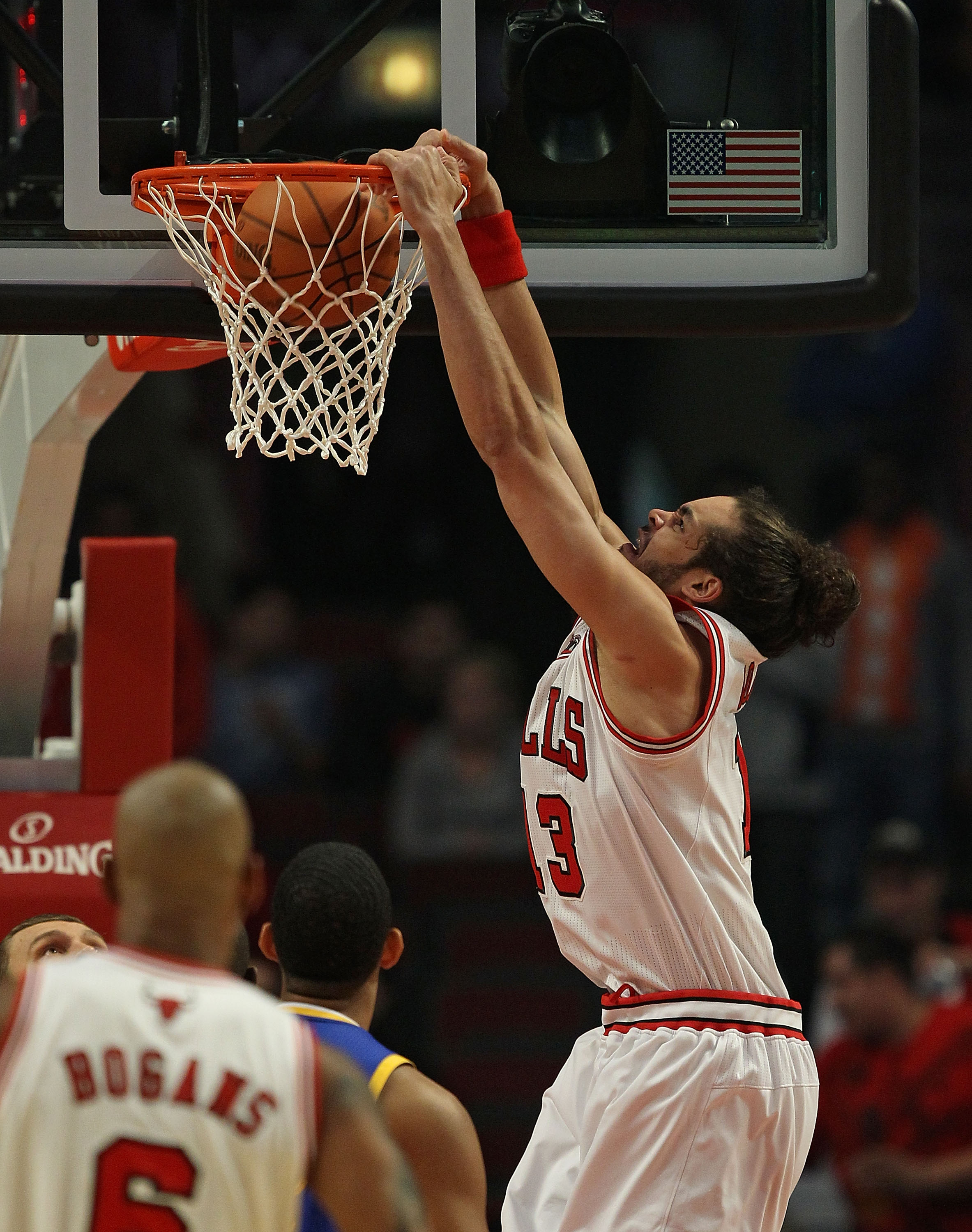 CHICAGO - NOVEMBER 11: Joakim Noah #13 of the Chicago Bulls dunks the ball against the Golden State Warriors at the United Center on November 11, 2010 in Chicago, Illinois. NOTE TO USER: User expressly acknowledges and agrees that, by downloading and/or u