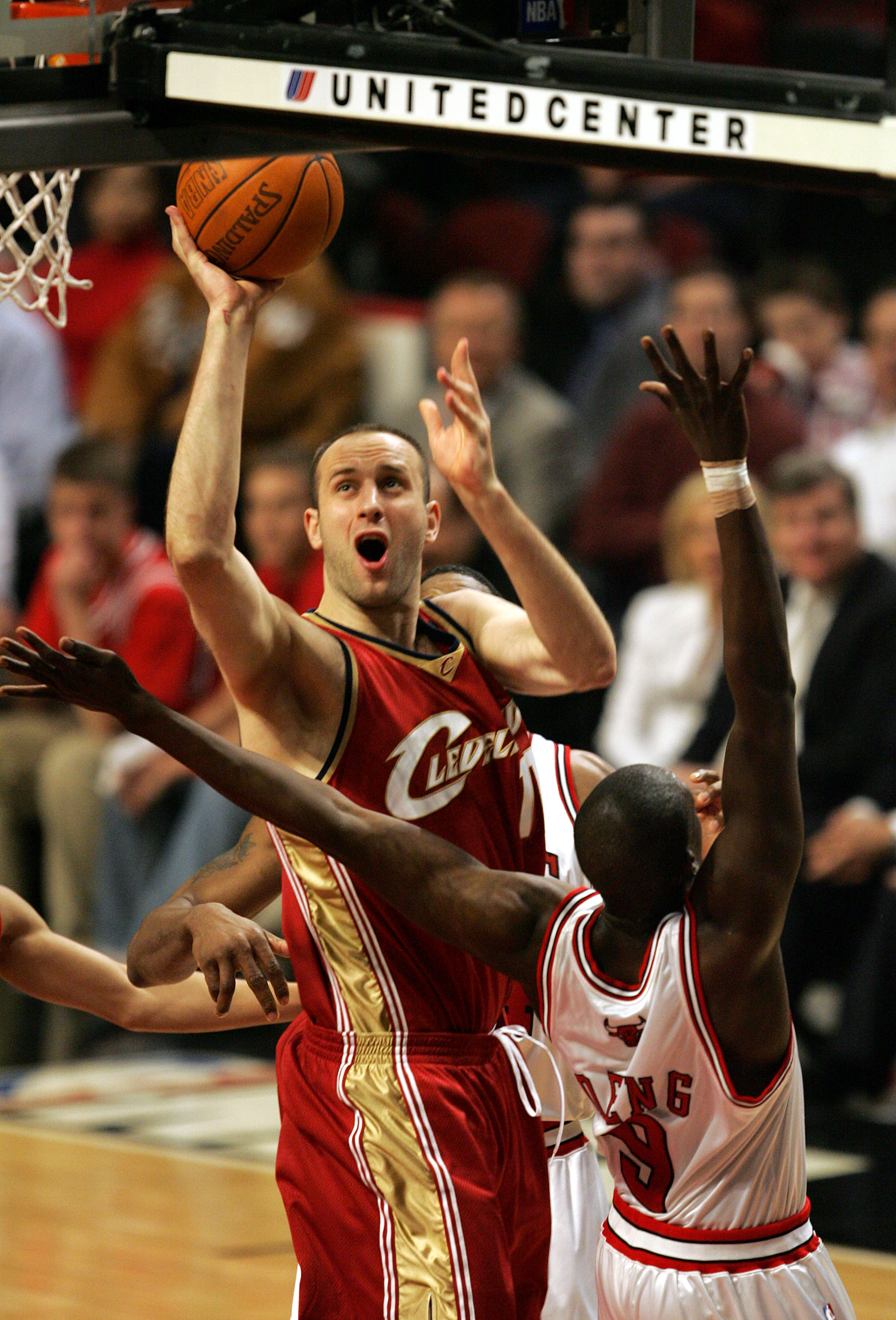 CHICAGO - MARCH 31:  Zydrunas Ilgauskas #11 of the Cleveland Cavaliers shoots over Luol Deng #9 of the Chicago Bulls during the game on March 31, 2005 at the United Center in Chicago, Illinois. The Bulls defeated the Cavaliers 102-90 in overtime. NOTE TO